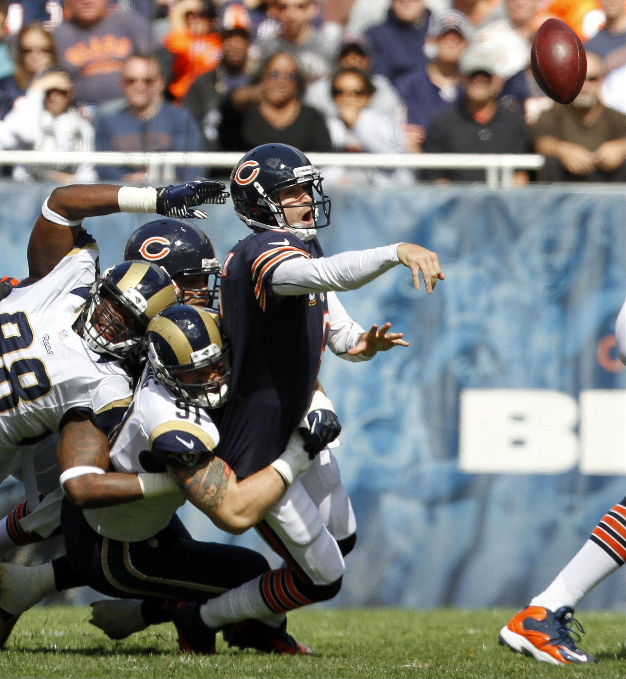 Chicago Bears quarterback Jay Cutler throws as he gets hit in the first half against the St. Louis Rams Sunday at Soldier Field in Chicago.