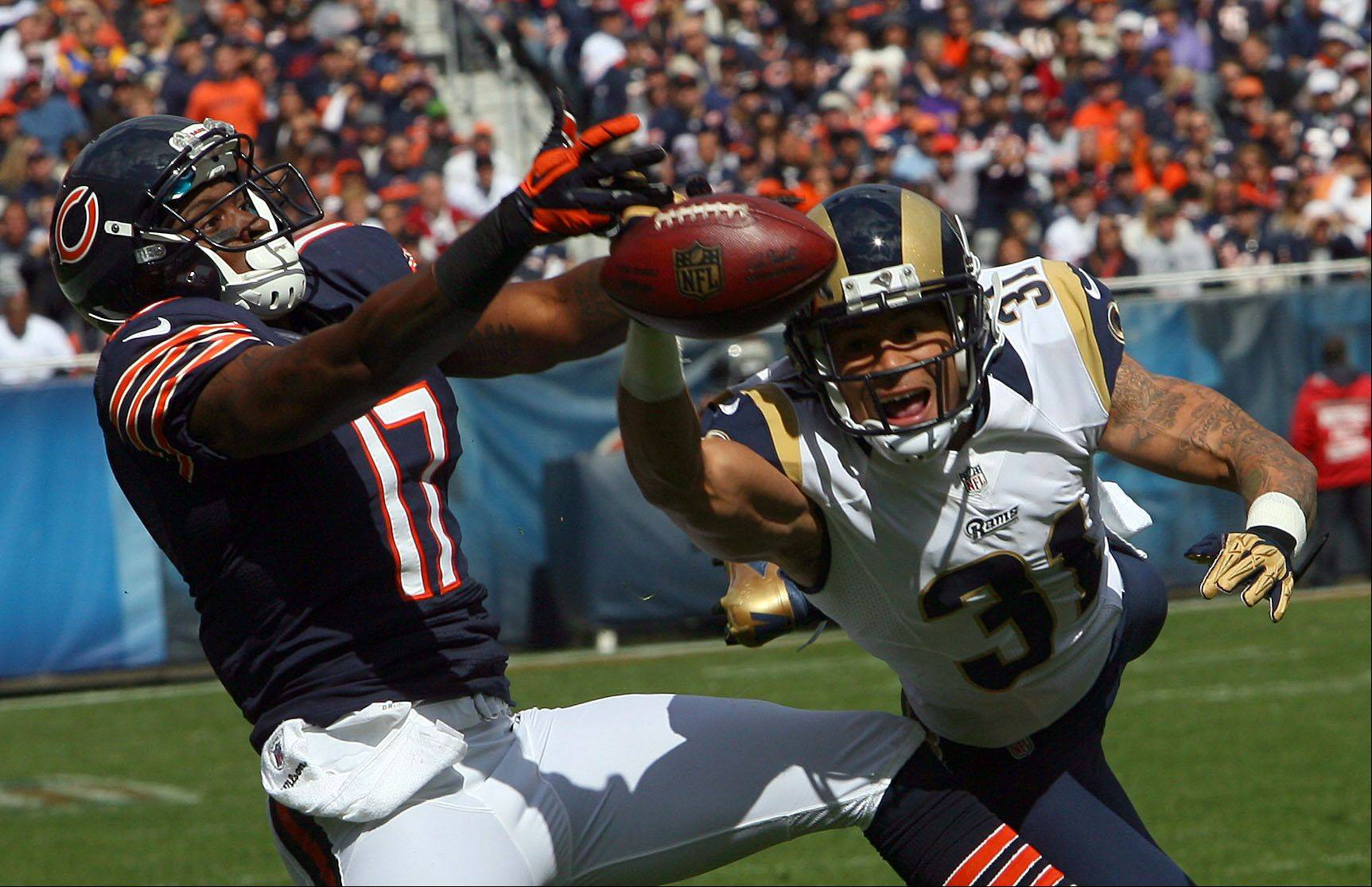 Chicago Bears wide receiver Alshon Jeffery goes for a ball with St. Louis Rams defensive back Cortland Finnegan in the first half against the St. Louis Rams Sunday at Soldier Field in Chicago. The pass was incomplete.