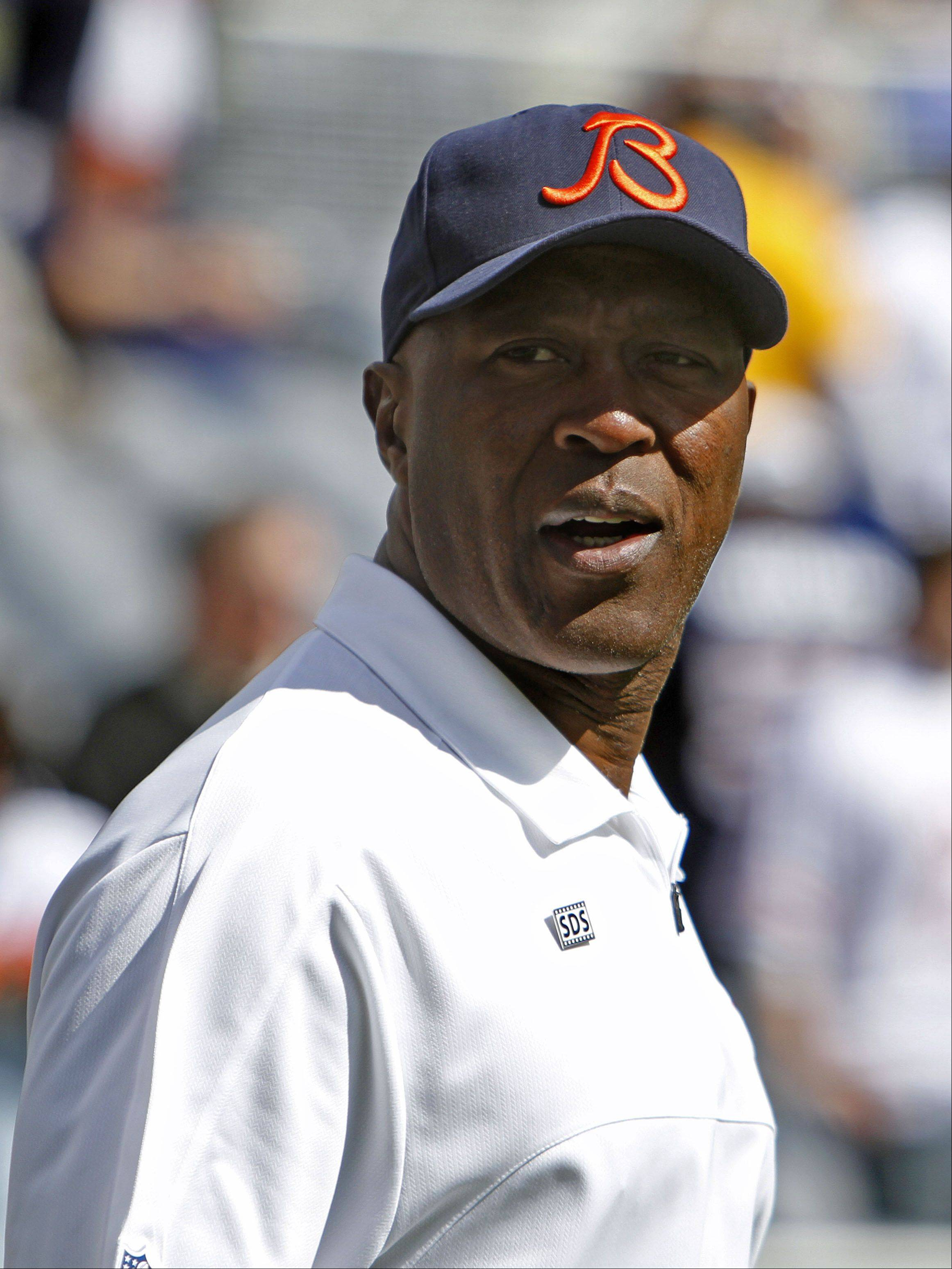 Chicago Bears Bears' coach Lovie Smith walks the sidelines prior to their game Sunday at Soldier Field in Chicago.