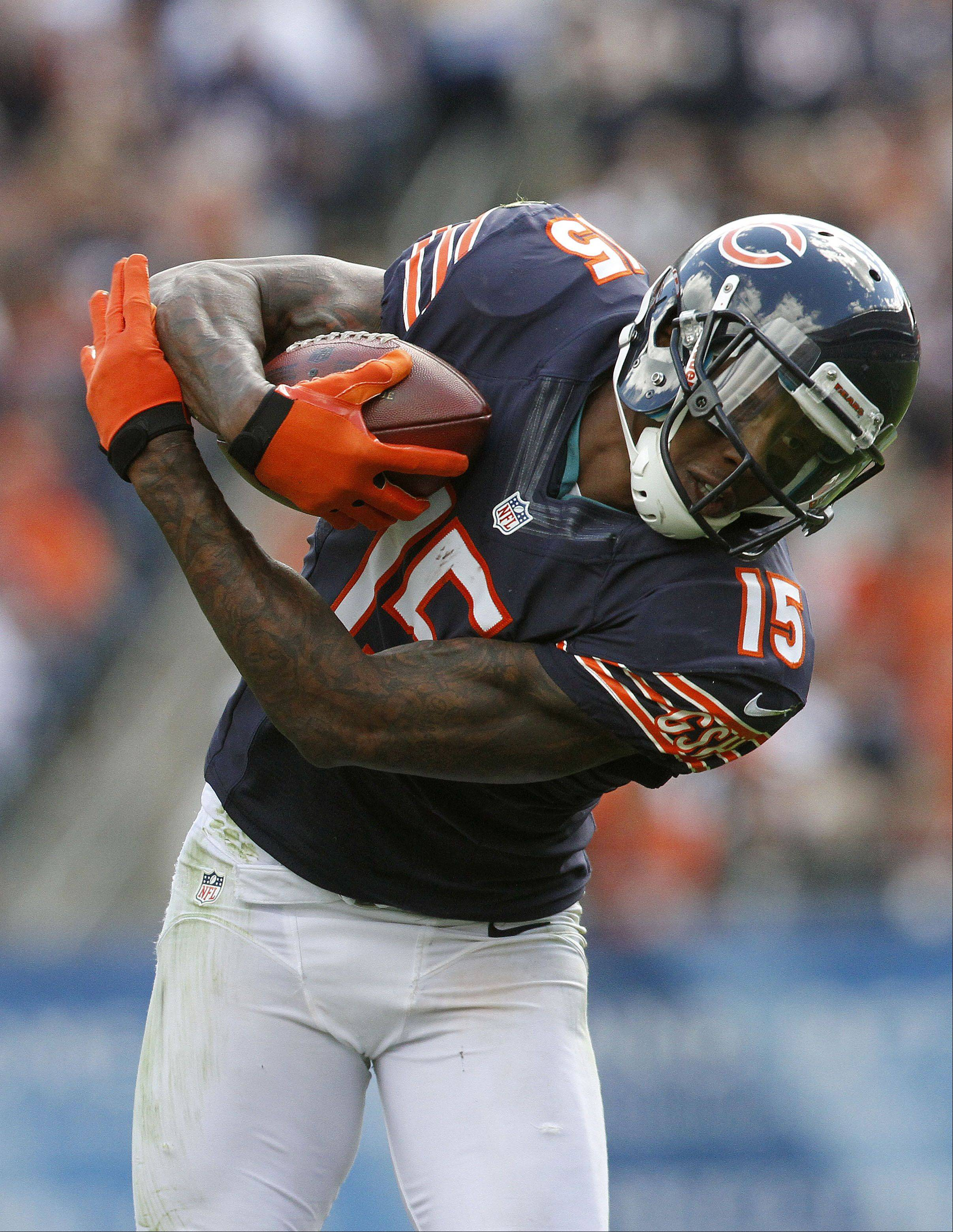 Chicago Bears wide receiver Brandon Marshall runs after a catch in the first half against the St. Louis Rams Sunday at Soldier Field in Chicago.