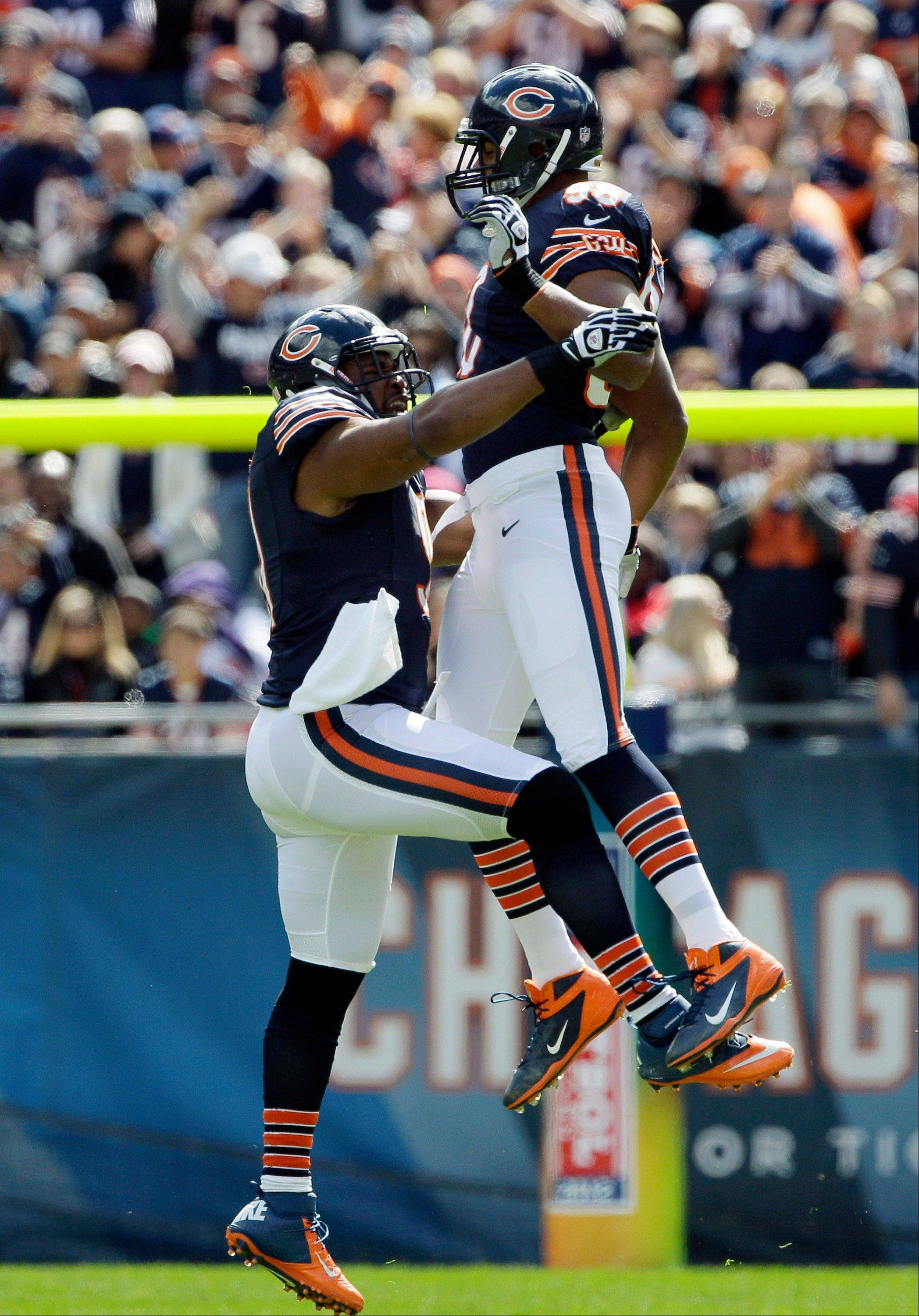 Chicago Bears defensive tackle Amobi Okoye, left, celebrates his sack of the St. Louis Rams quarterback with defensive end Corey Wootton in the first half of an NFL football game in Chicago, Sunday.