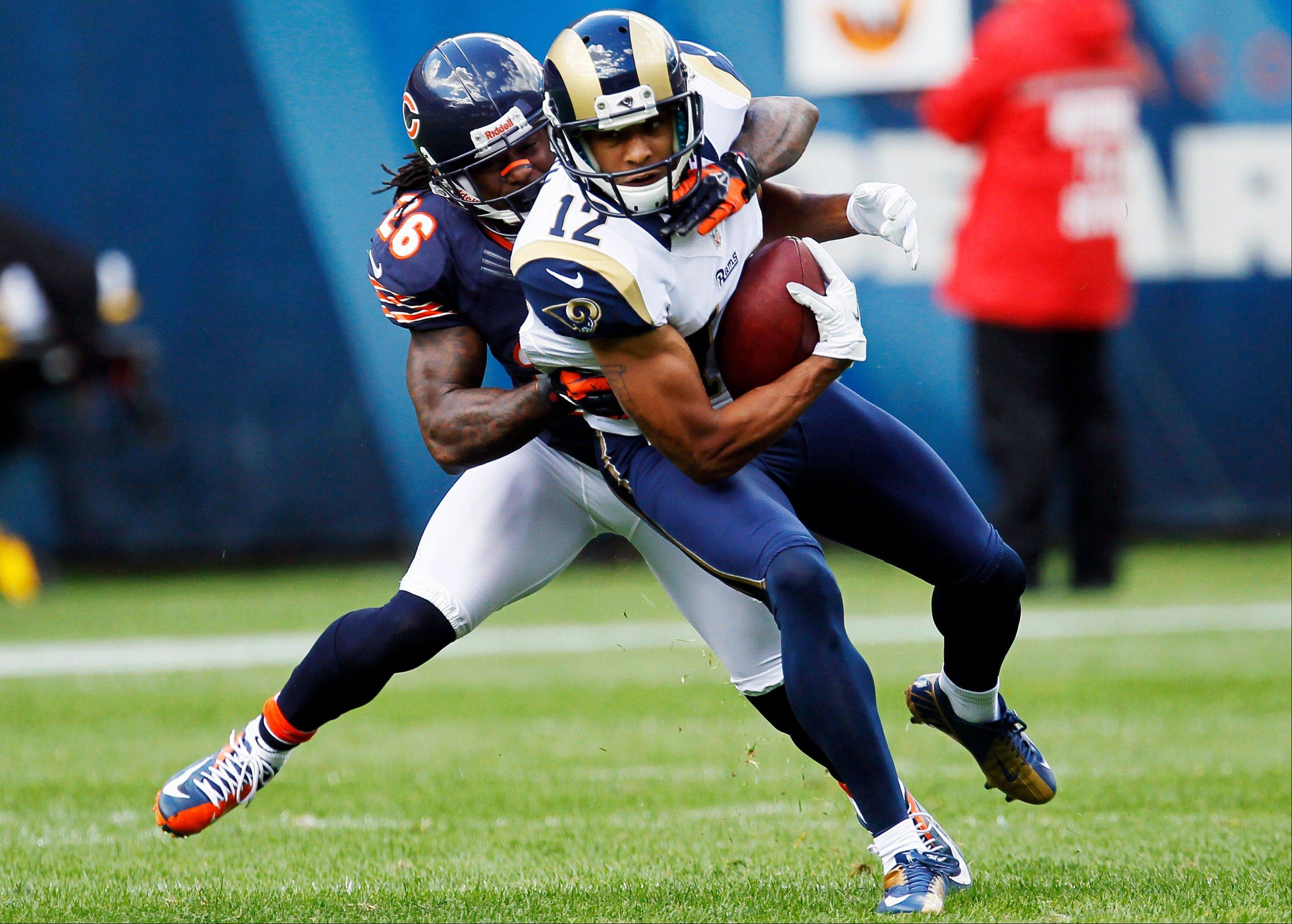 St. Louis Rams wide receiver Steve Smith is tackled from behind by Chicago Bears cornerback Tim Jennings in the first half of the NFL football game in Chicago, Sunday.