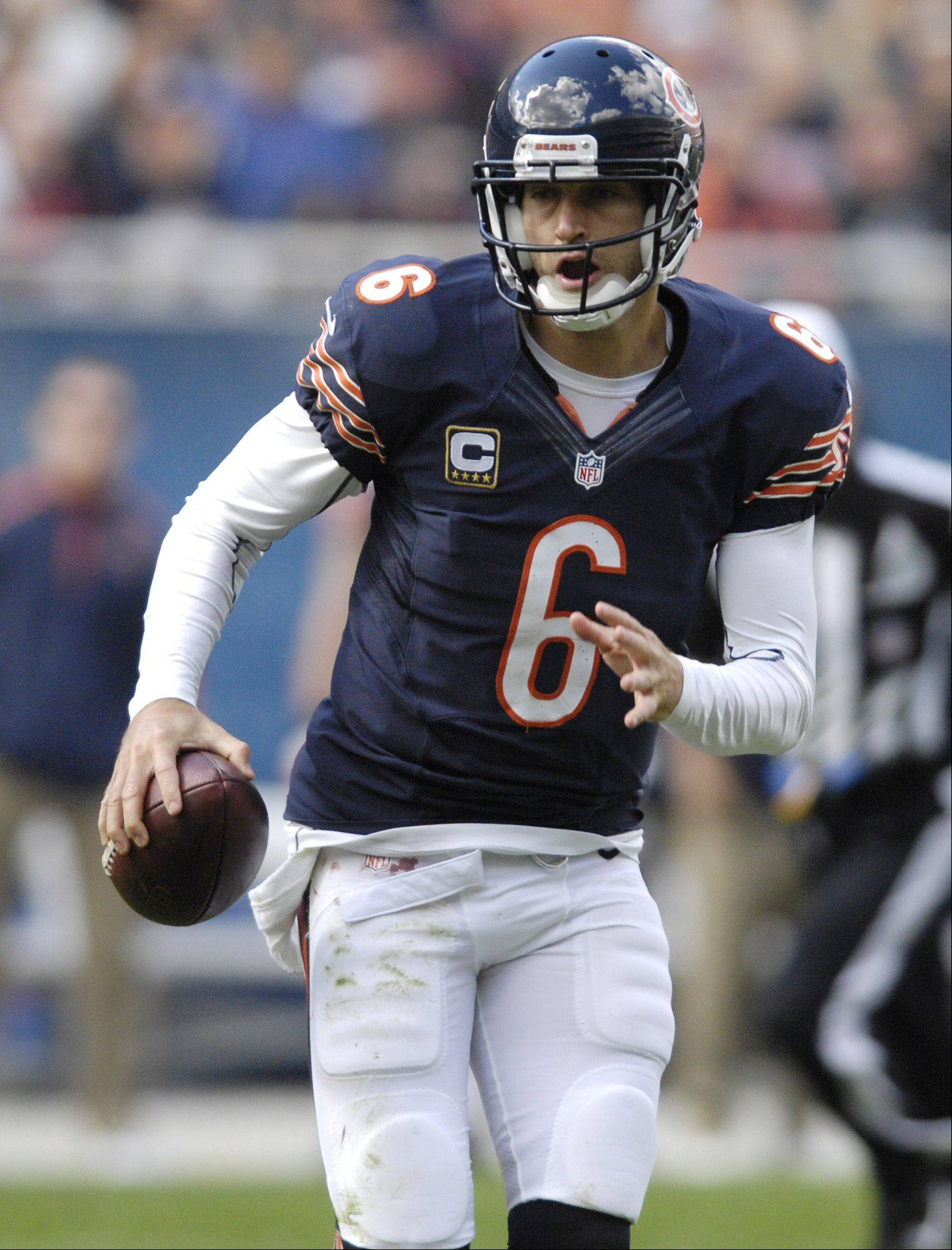 Chicago Bears quarterback Jay Cutler scrambles with the ball against the St. Louis Rams at Soldier Field in Chicago.