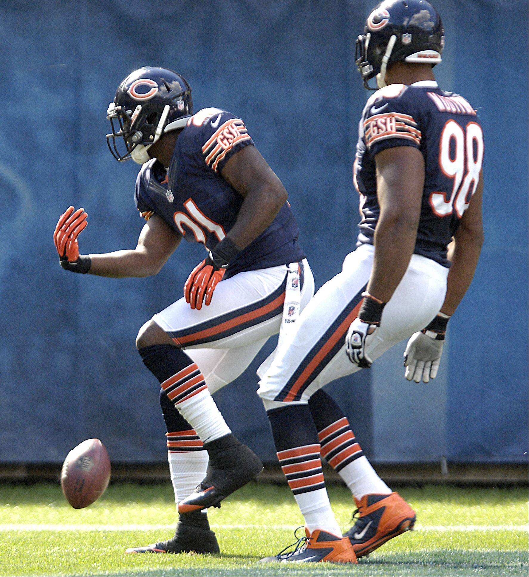 Chicago Bears strong safety Major Wright celebrates his touchdown on an interception against the St. Louis Rams at Soldier Field in Chicago.