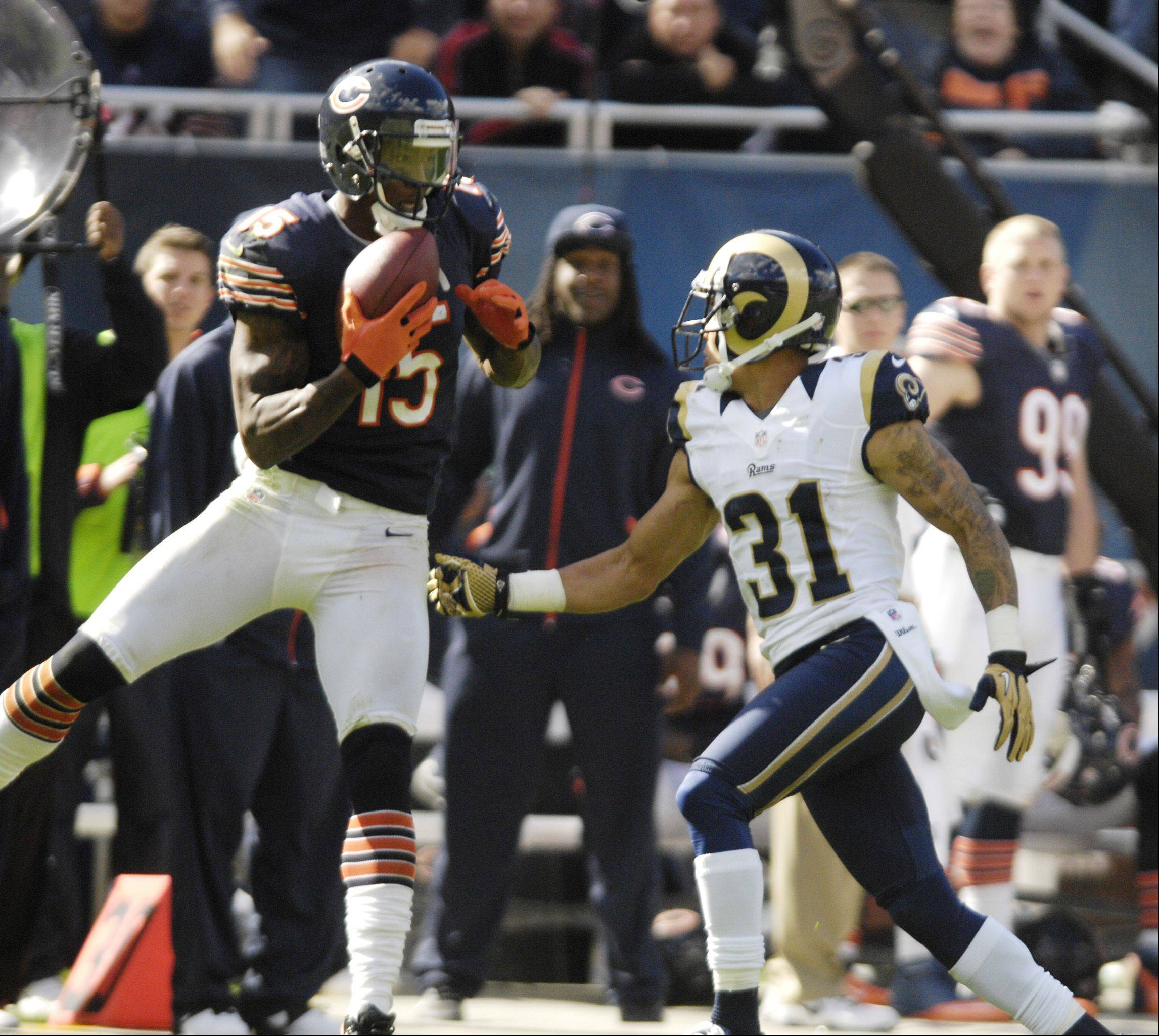 Chicago Bears wide receiver Brandon Marshall makes a catch as St. Louis Rams cornerback Cortland Finnegan quickly takes him down.