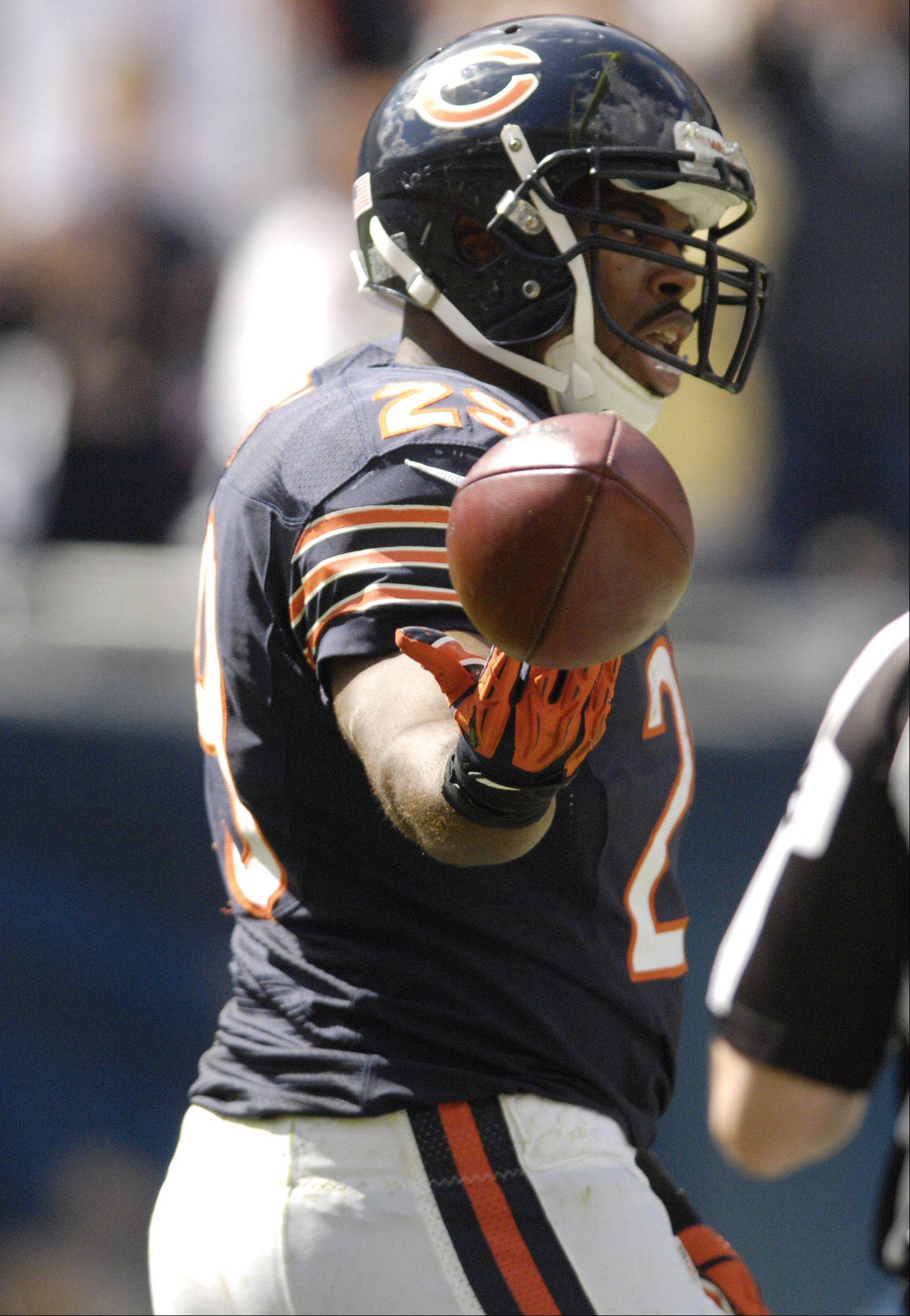 Chicago Bears running back Michael Bush scores a touchdown against the St. Louis Rams at Soldier Field in Chicago.