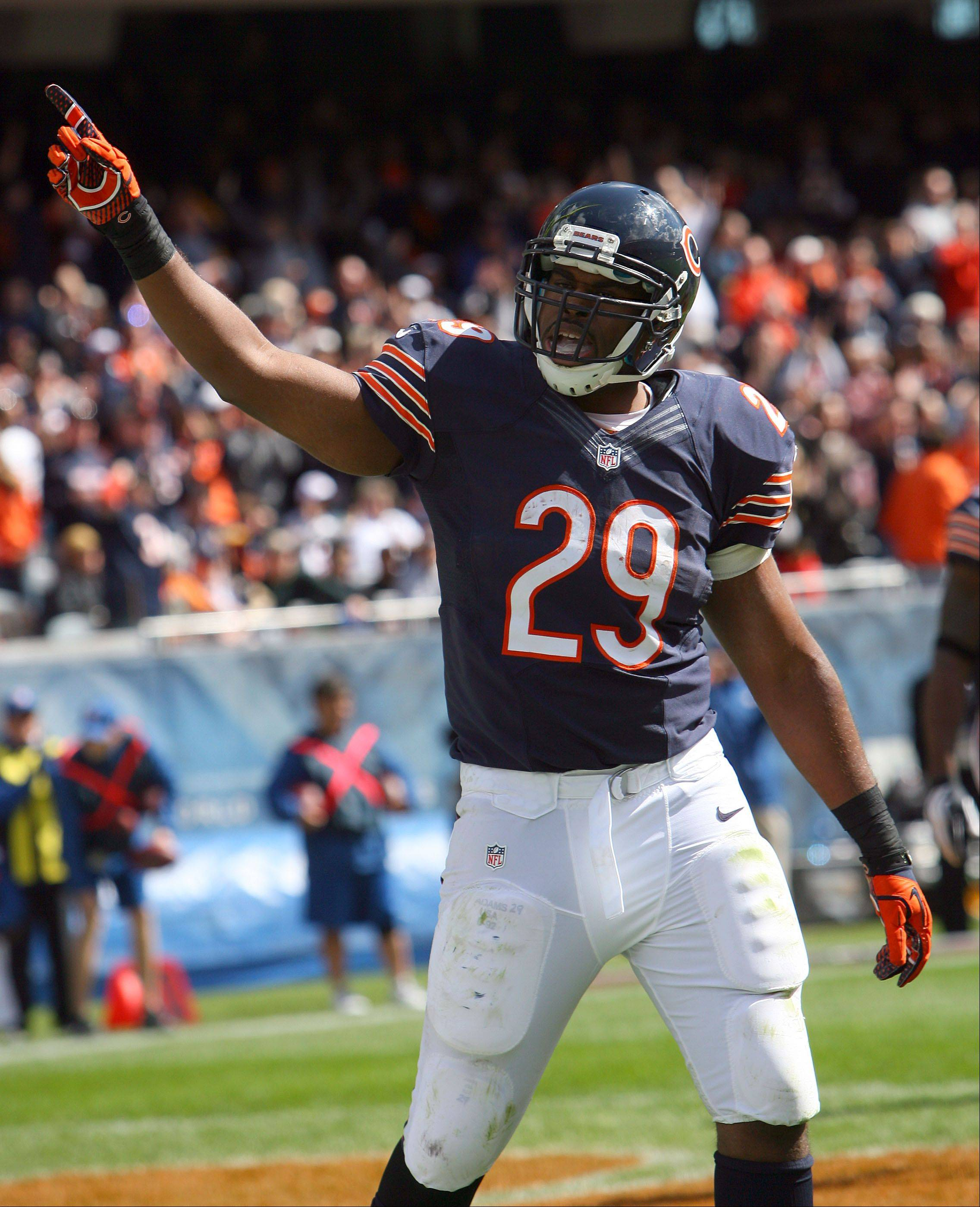 Chicago Bears running back Michael Bush points to the crowd after scoring in the first half against the St. Louis Rams Sunday at Soldier Field in Chicago.