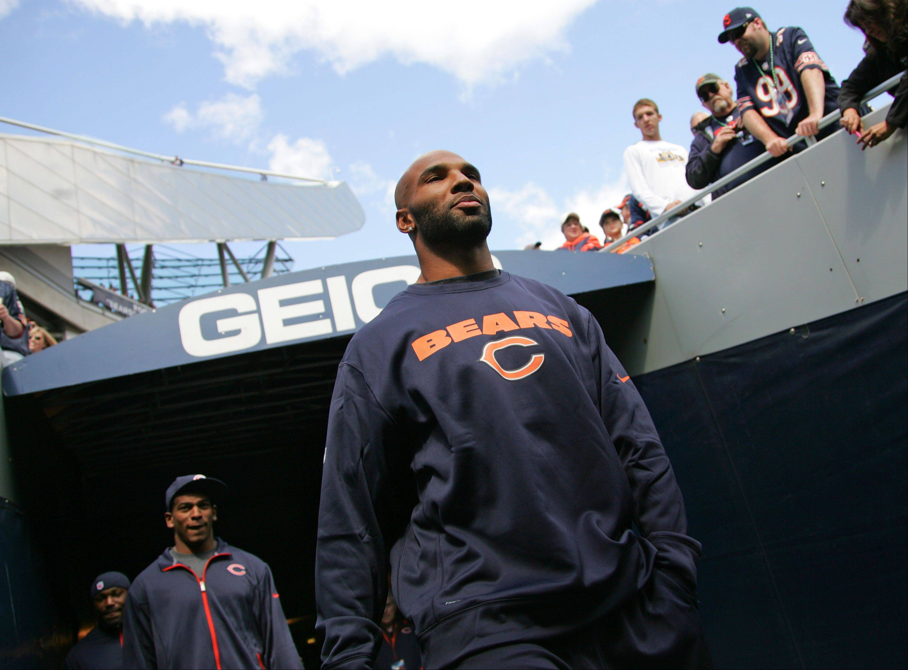 Chicago Bears running back Matt Forte comes out on the field in street clothes during the Bears game against the St. Louis Rams Sunday at Soldier Field in Chicago.