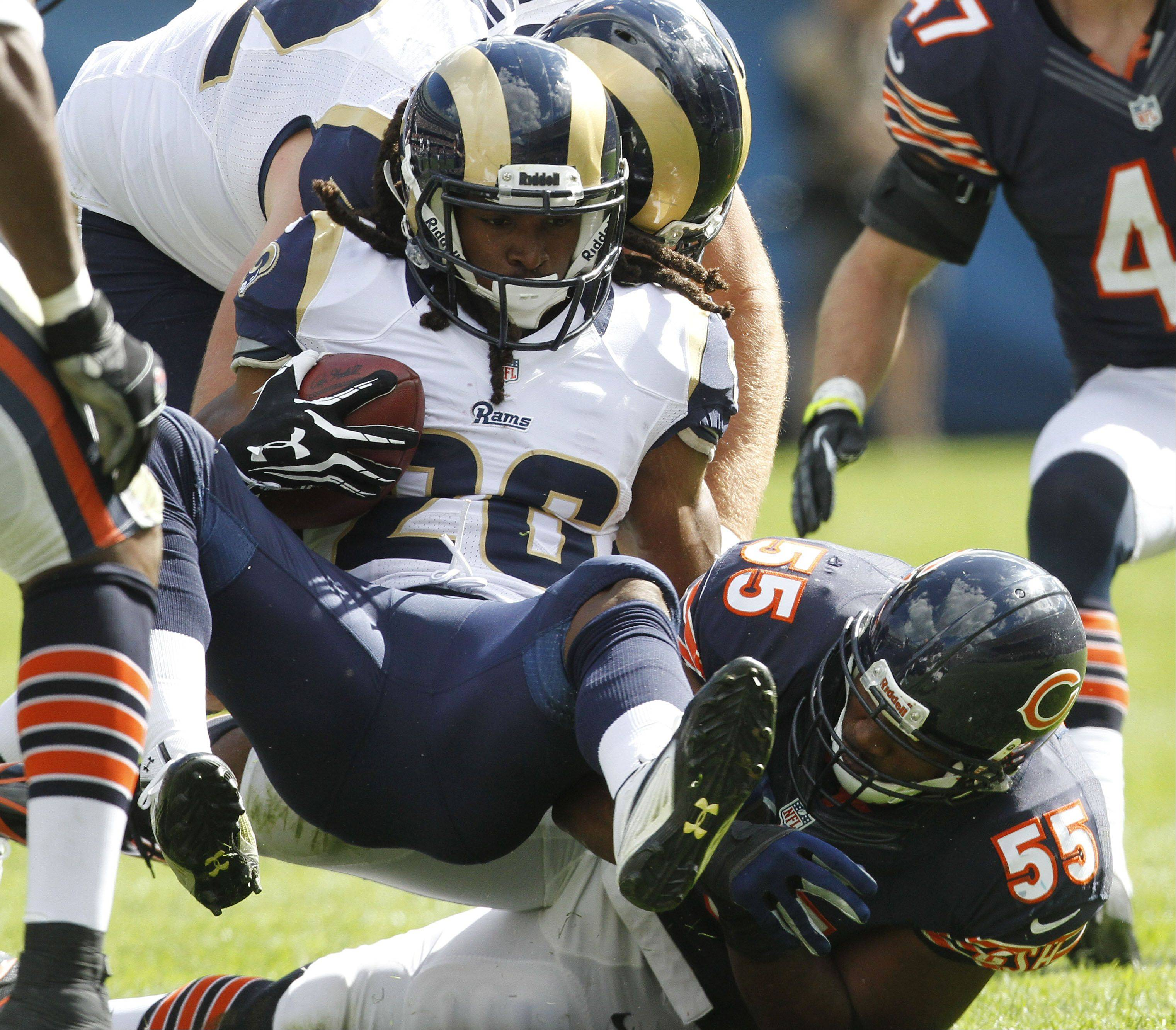 Chicago Bears linebacker Lance Briggs puts a hard hit on St. Louis Rams running back Daryl Richardson during the Bears 23-6 win over the St. Louis Rams Sunday at Soldier Field in Chicago.