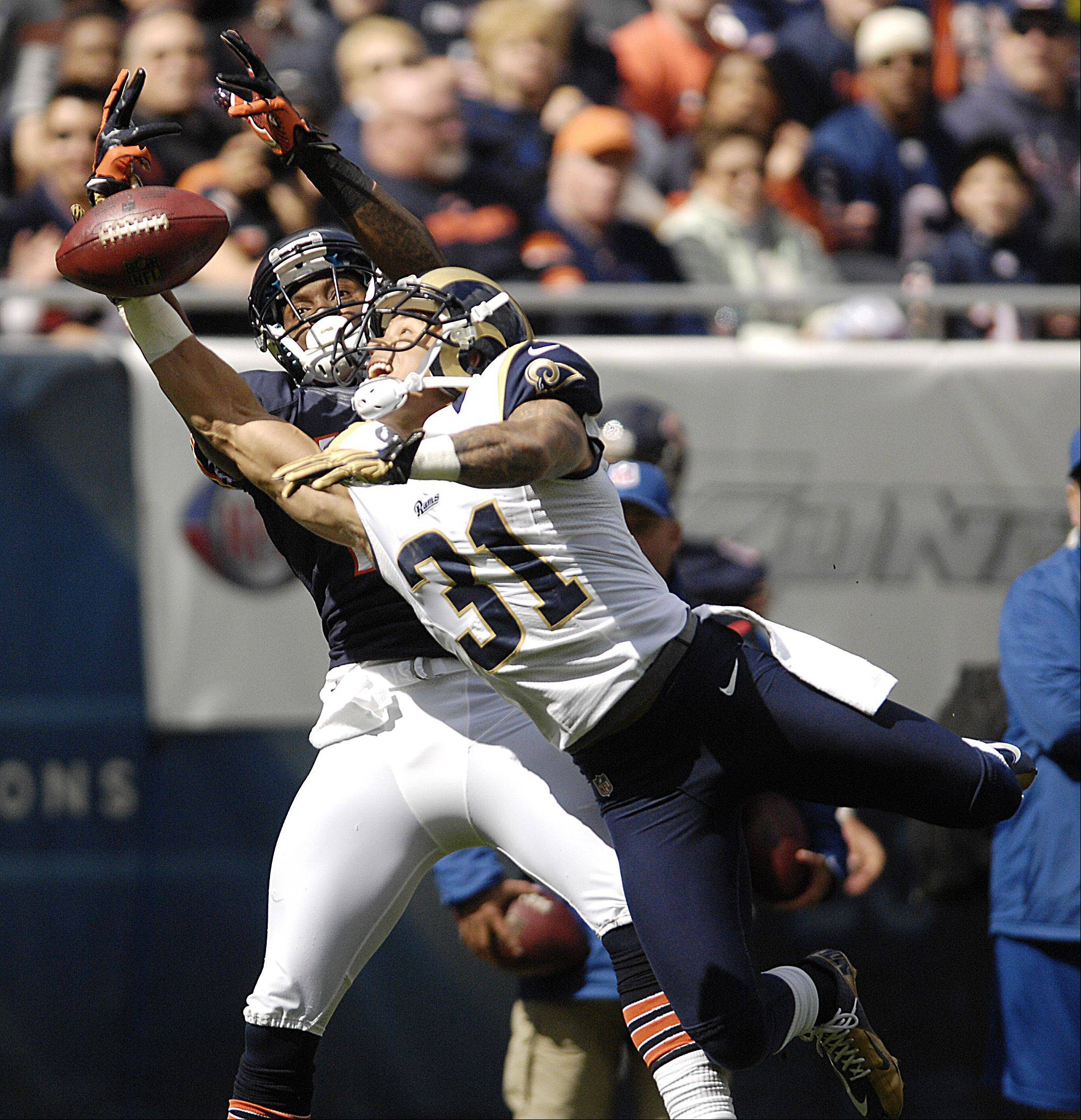 A pass intended for Chicago Bears wide receiver Alshon Jeffery is deflected by St. Louis Rams cornerback Cortland Finnegan during the Bears 23-6 win at Soldier Field in Chicago.