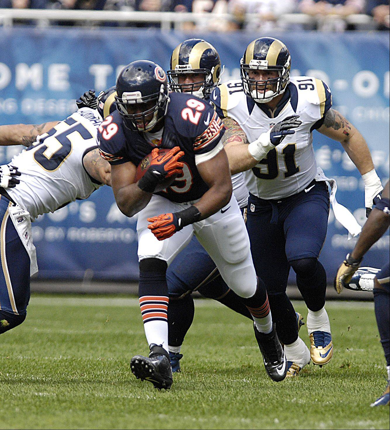 Chicago Bears running back Michael Bush makes some yardage against the St. Louis Rams at Soldier Field in Chicago.