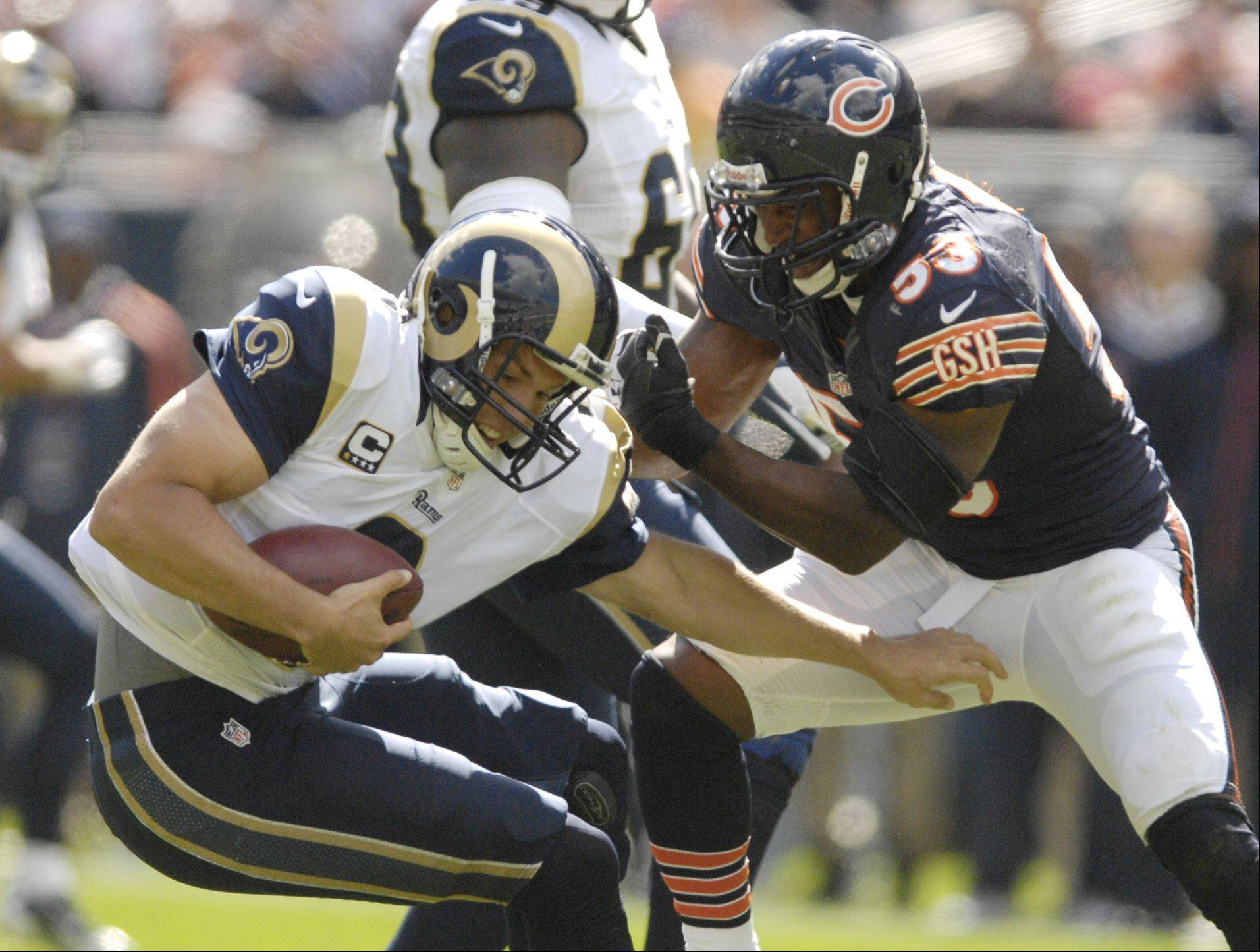 St. Louis Rams quarterback Sam Bradford is sacked by Chicago Bears outside linebacker Nick Roach at Soldier Field in Chicago.