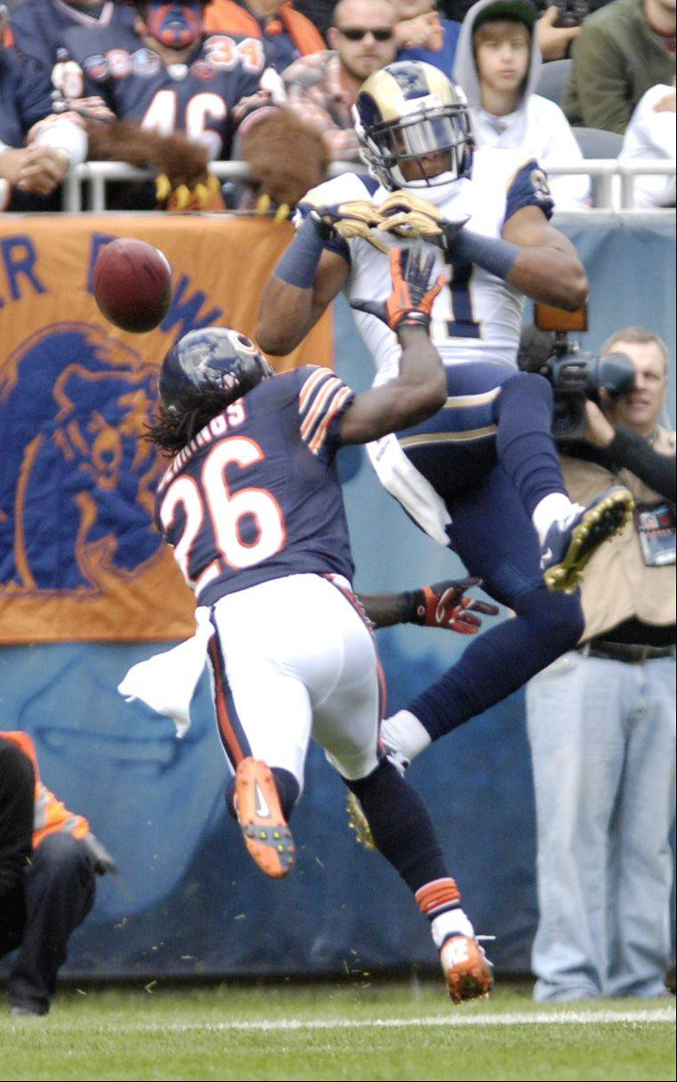 Chicago Bears cornerback Tim Jennings keeps pressure on St. Louis Rams wide receiver Brandon Gibson during the first half at Soldier Field in Chicago.