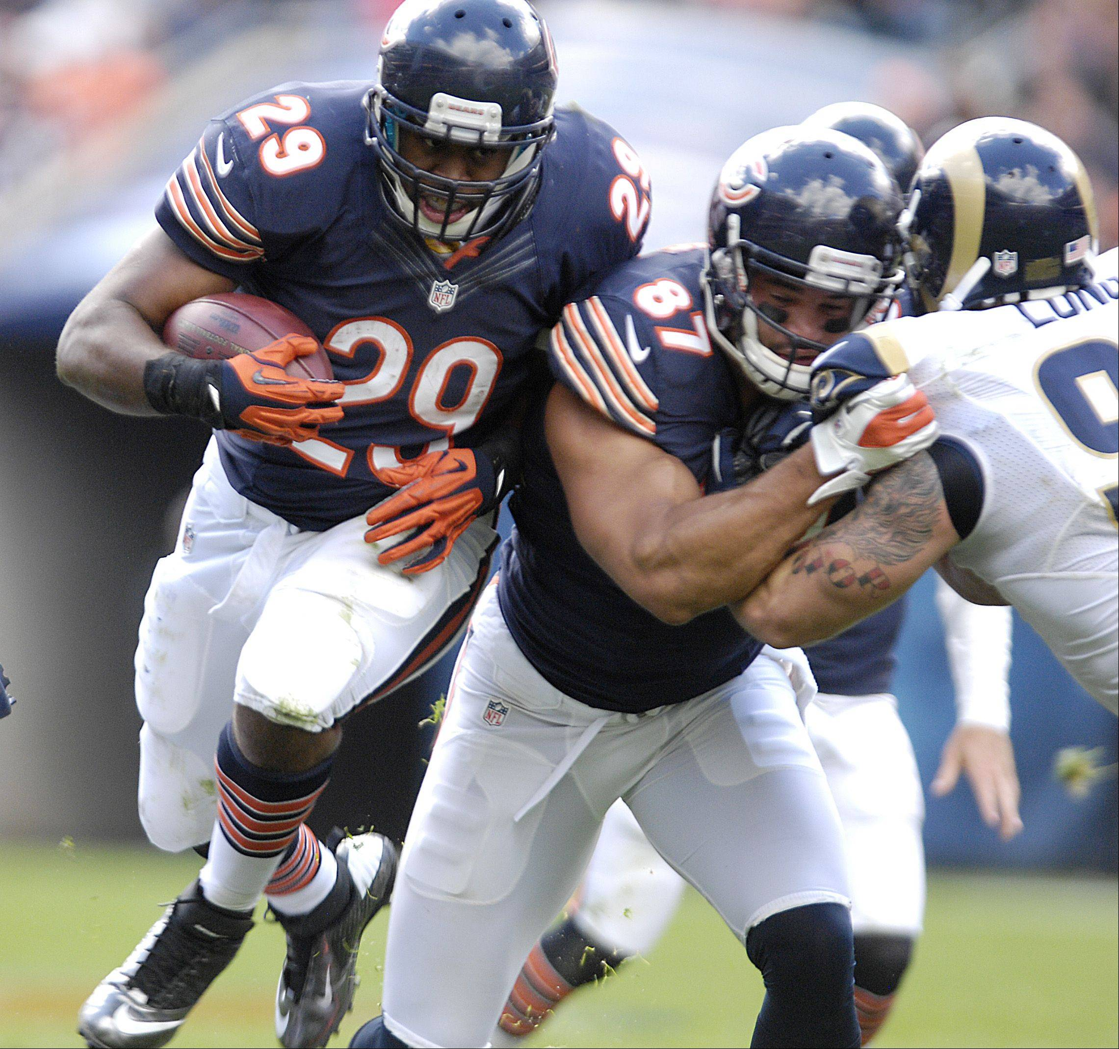 Chicago Bears running back Michael Bush works to gain some yards during play against the St. Louis Rams at Soldier Field in Chicago.
