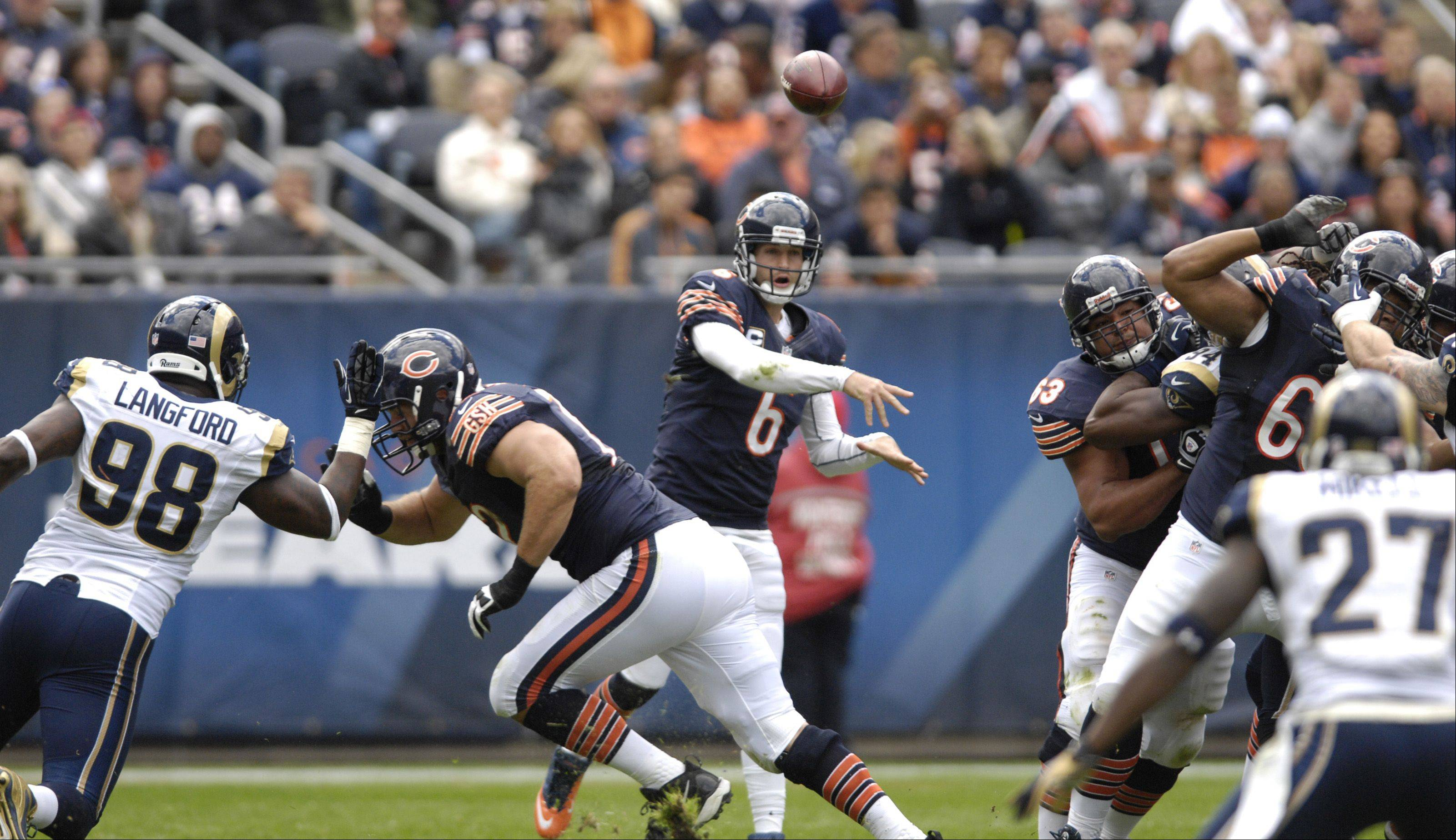 Chicago Bears quarterback Jay Cutler passes the ball during play against the St. Louis Rams at Soldier Field in Chicago.