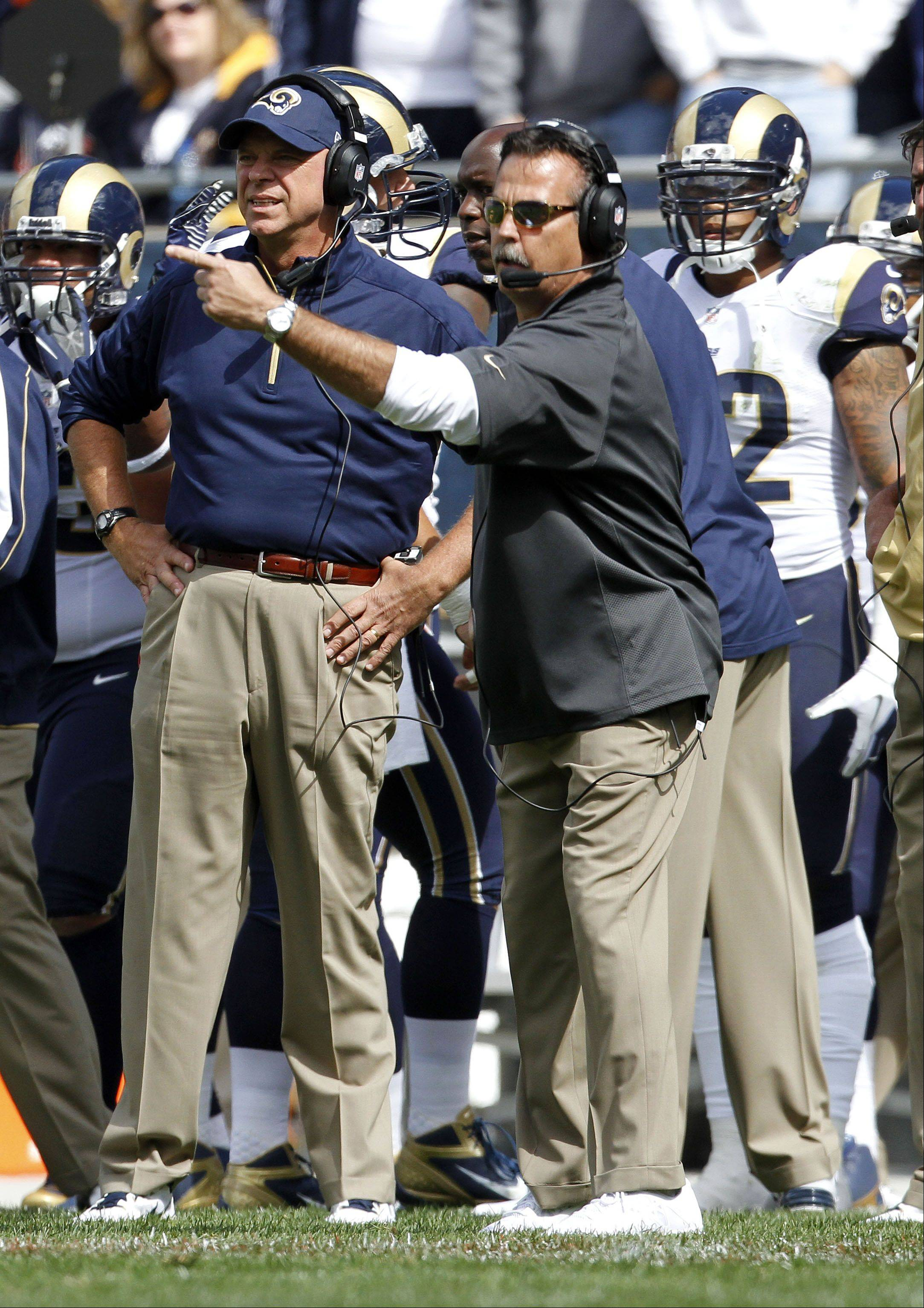 St. Louis Rams coach Jeff Fisher talks on the sidelines Sunday at Soldier Field in Chicago.