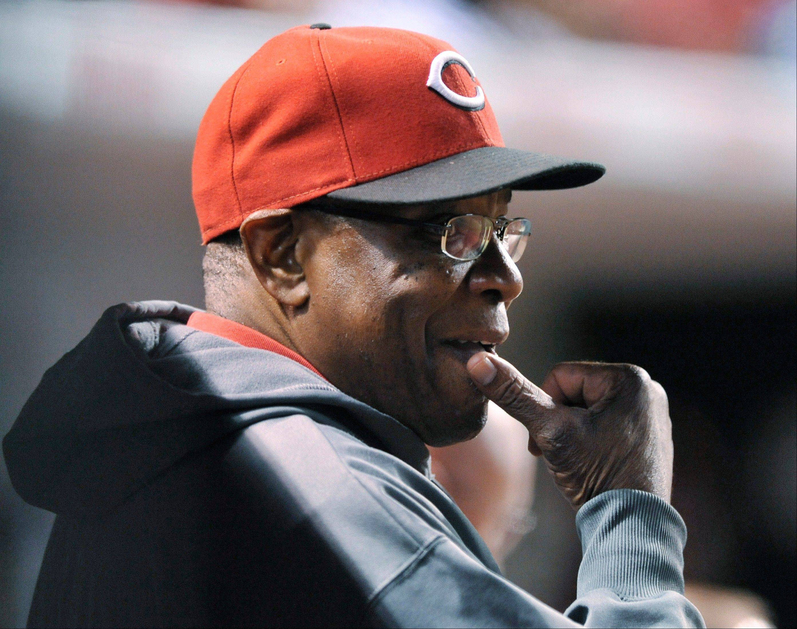 Cincinnati Reds manager Dusty Baker watches during the seventh inning of a game against the Chicago Cubs on Tuesday. He was hospitalized the next day.