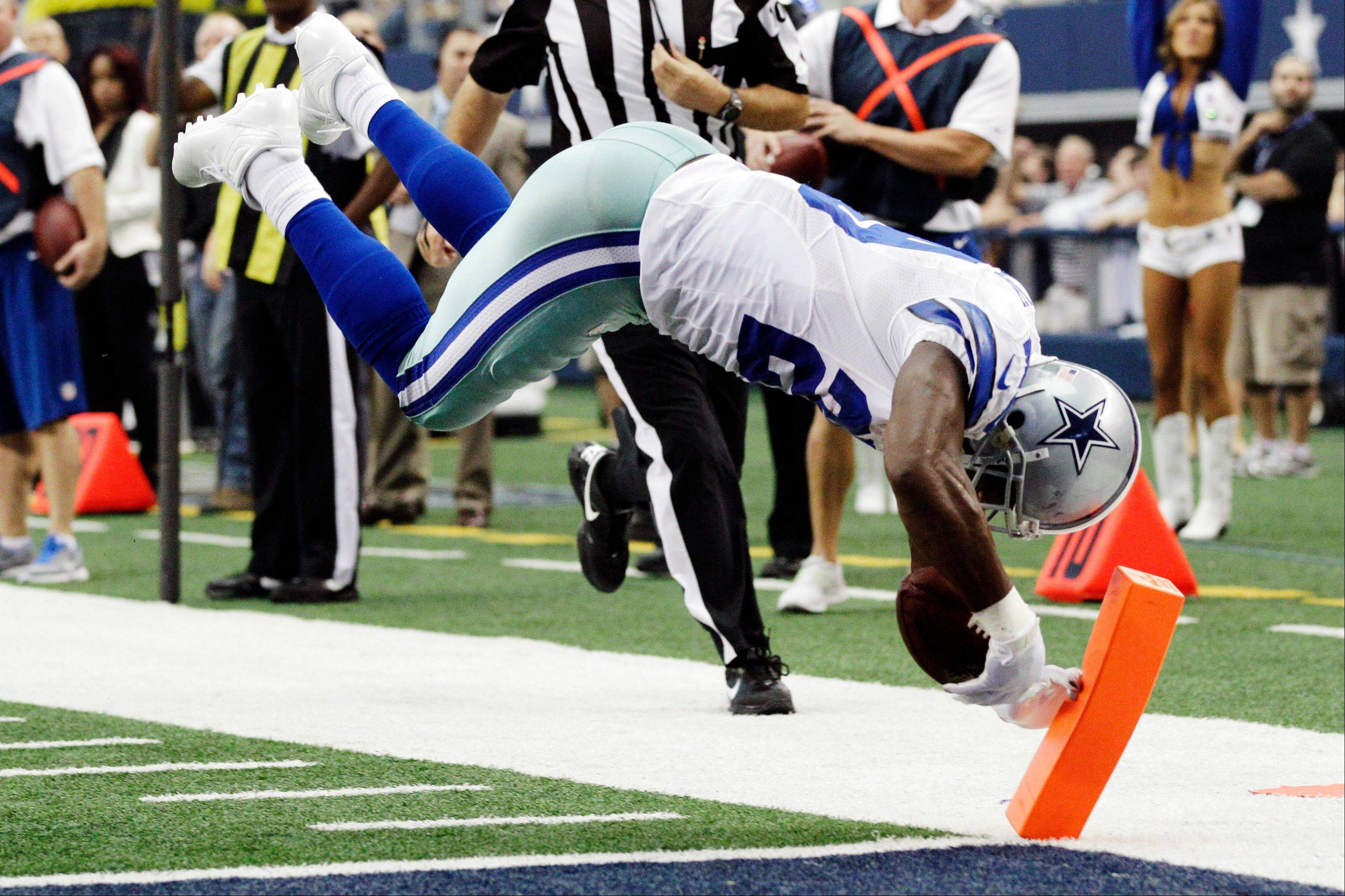 Dallas running back DeMarco Murray dives for a touchdown against the Tampa Bay Buccaneers during the first half Sunday in Arlington, Texas.