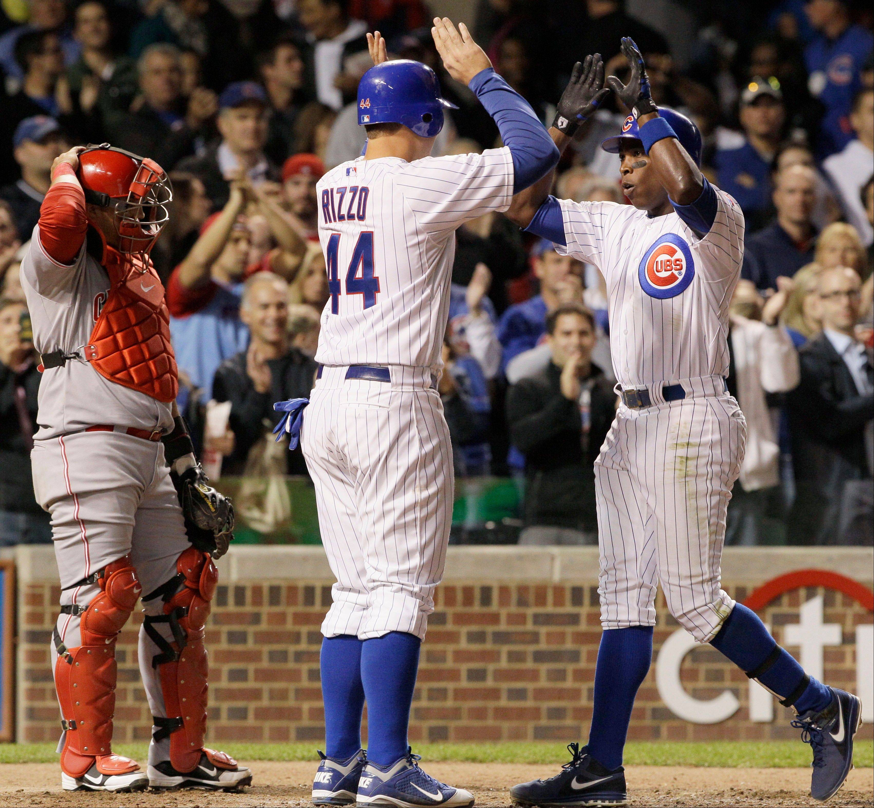 Alfonso Soriano, right, has a chance to win the RBI title as the Cubs enter the final days of the regular season. Soriano and Darwin Barney are also contenders for Gold Glove awards.