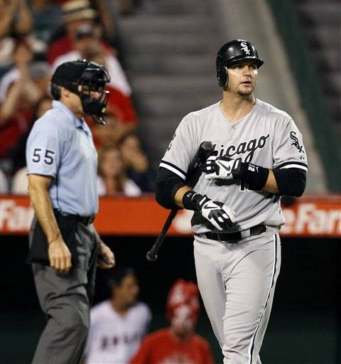 A.J. Pierzynski walks back to the dugout after striking out in the ninth inning of a baseball game against the Los Angeles Angels in Anaheim, Calif. The Sox are in big trouble after dropping 3 in a row.
