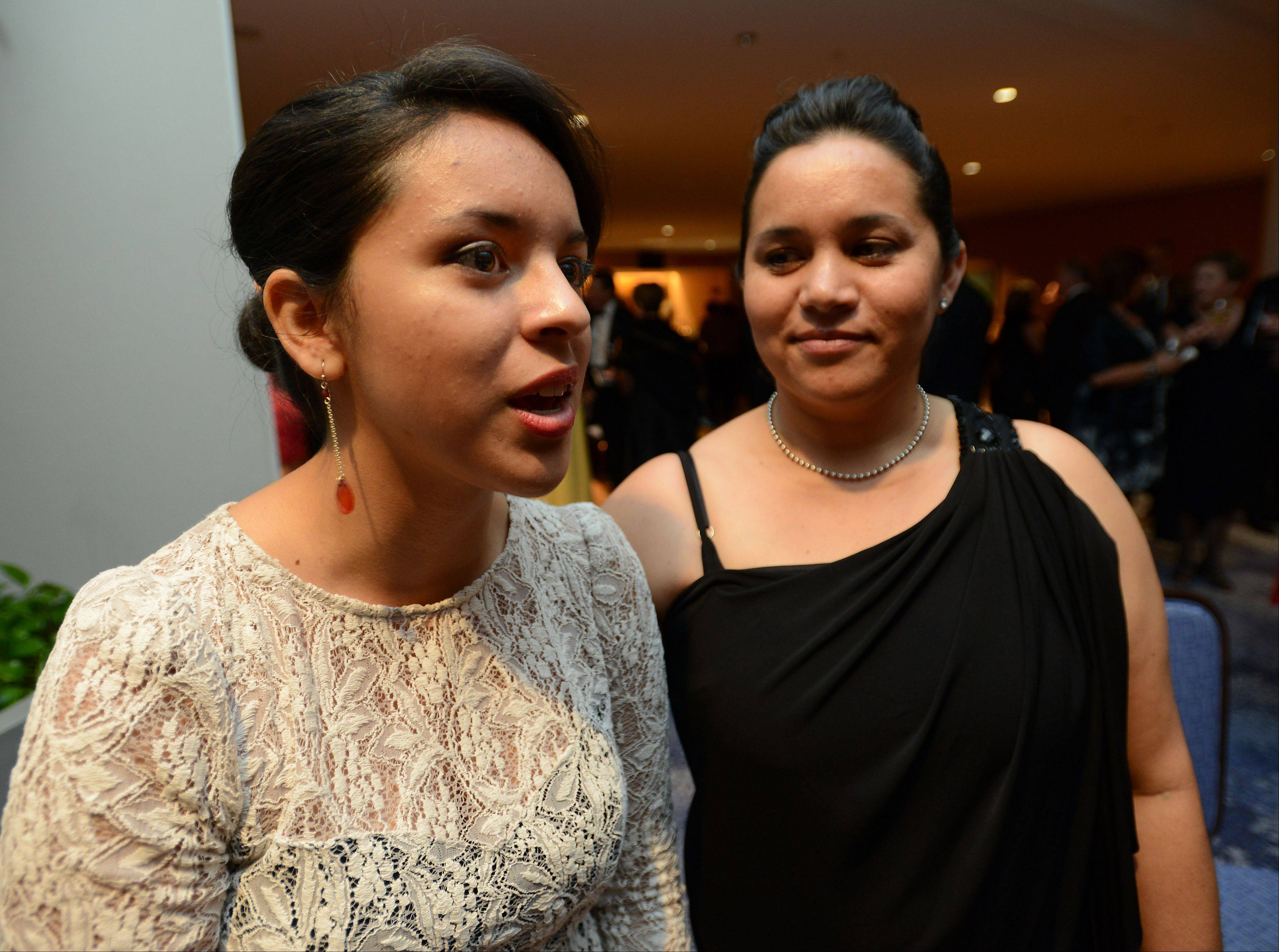 Mark Welsh/mwelsh@dailyherald.com Elisa Galvan, with her mother, Maricela Alva, discusses the speech she is about to give at The President's Ball gala fundraiser.