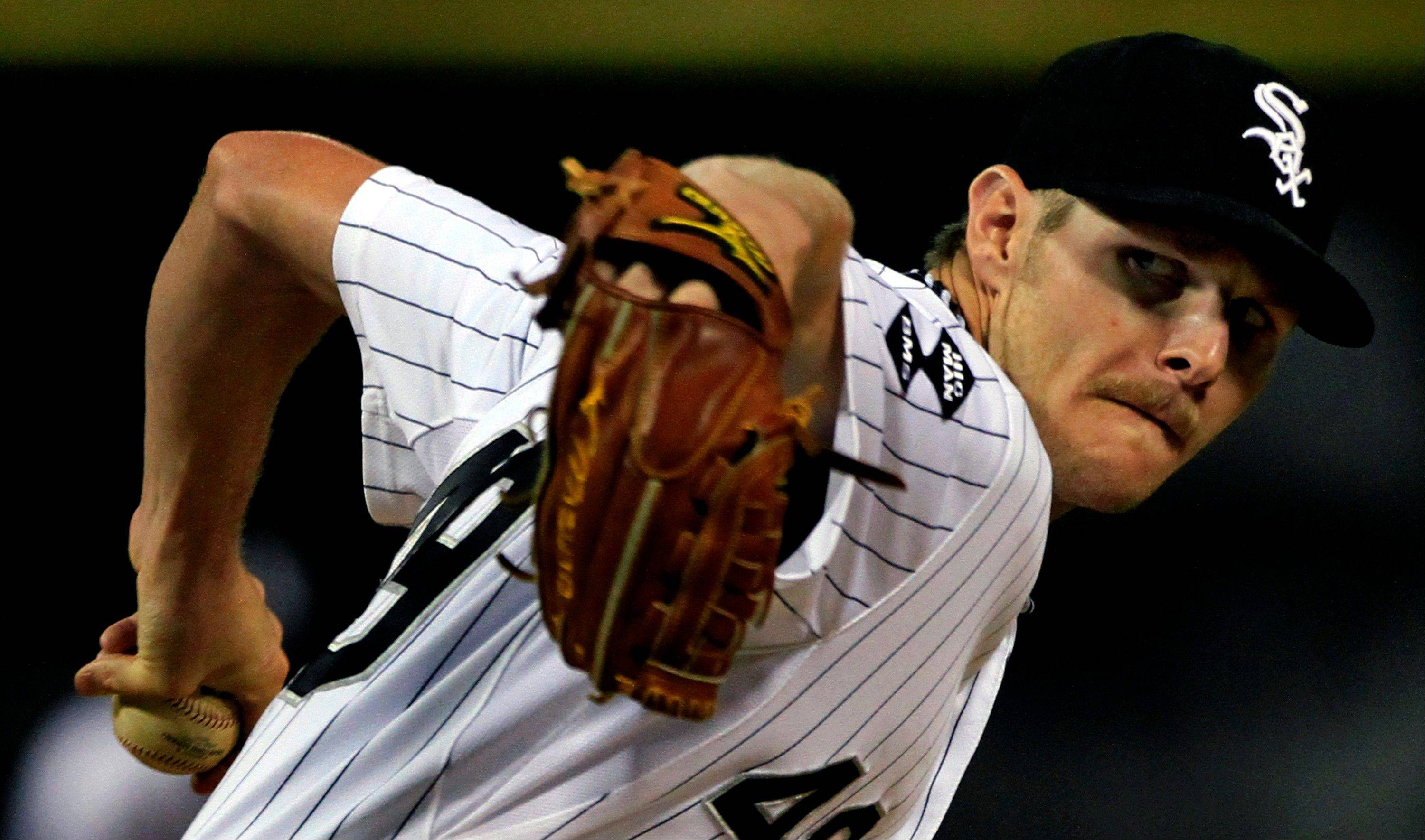 Chicago White Sox starting pitcher Chris Sale throws against the Cleveland Indians in the first inning during a baseball game Monday in Chicago.