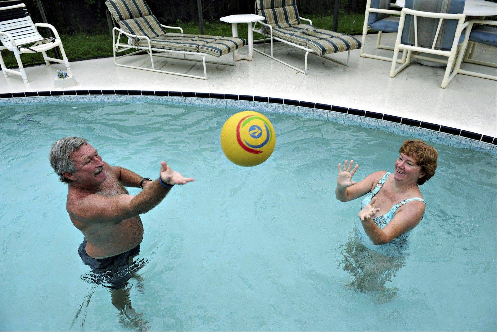 Tom and Linda Sinotte play ball in the pool to keep her skills sharp.