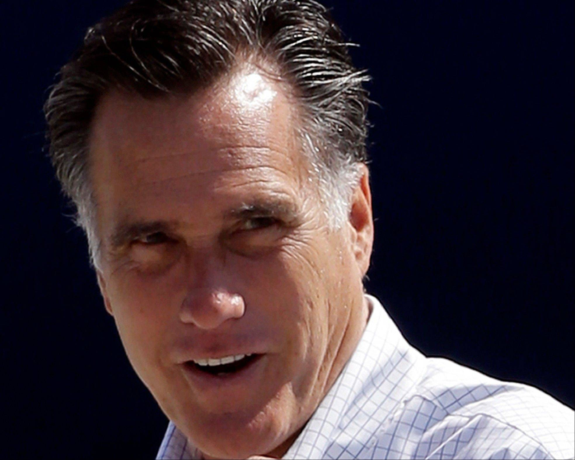 Republican presidential candidate, former Massachusetts Gov. Mitt Romney gets ready to board his campaign plane in Los Angeles on Sunday. Never have American voters voted a challenger with such high disapproval ratings into office against an incumbent president.