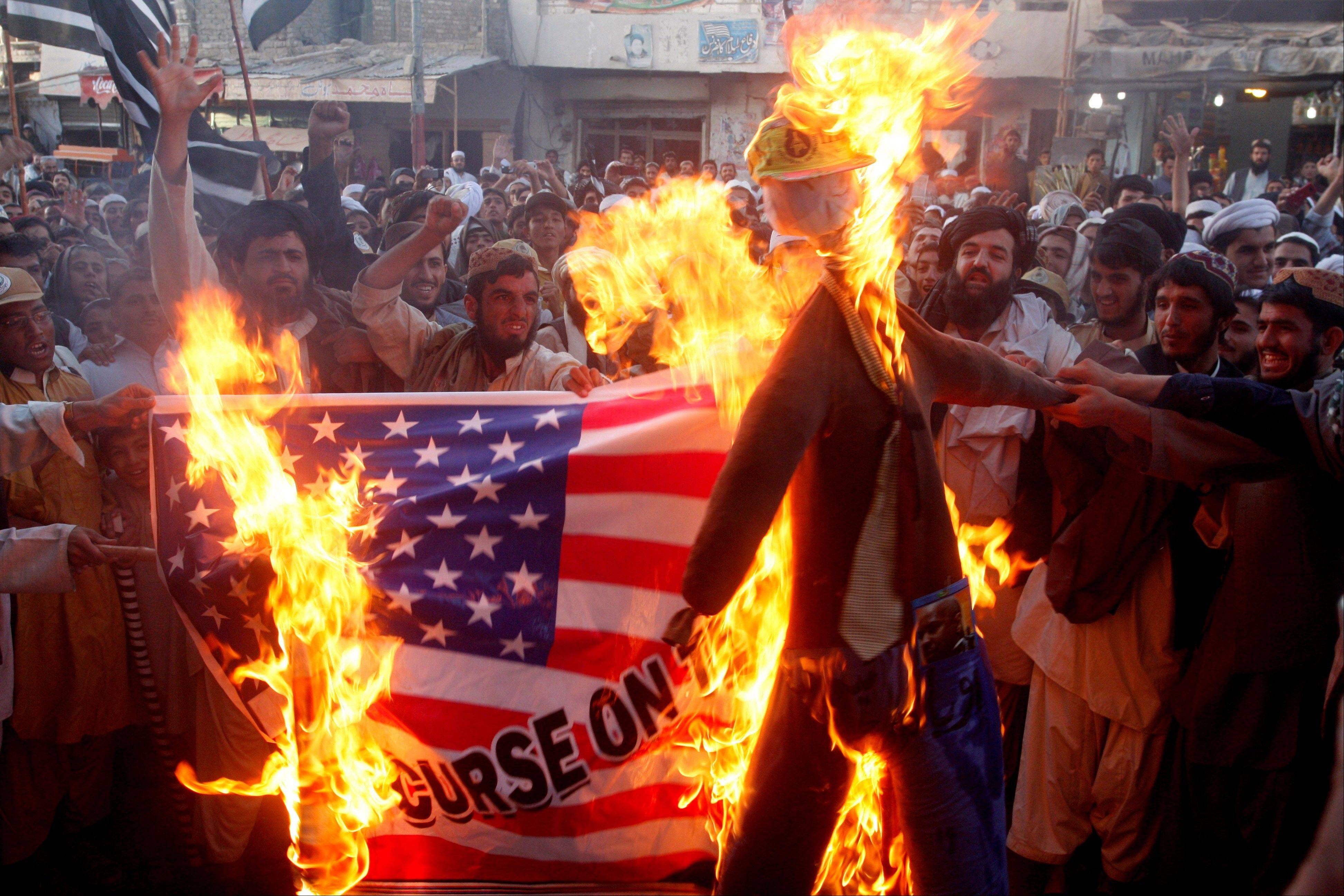 Pakistani protesters burn a representation of a U.S. flag and an effigy of U.S. President Barack Obama in the Pakistani border town of Chaman along the Afghanistan border. U.S.-funded ads on Pakistani television include President Barack Obama extolling America's religious tolerance. To many in the Muslim world, this misses the mark in efforts to calm the outrage over a film mocking the Prophet Muhammad.