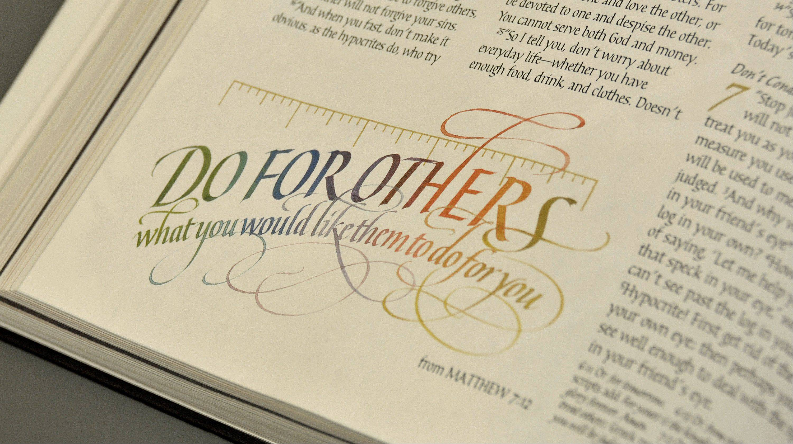 """Do for others what you would like them to do for you"" from Matthew 7 is one of 360 illustrations in Botts' calligraphy illustrated Bible."
