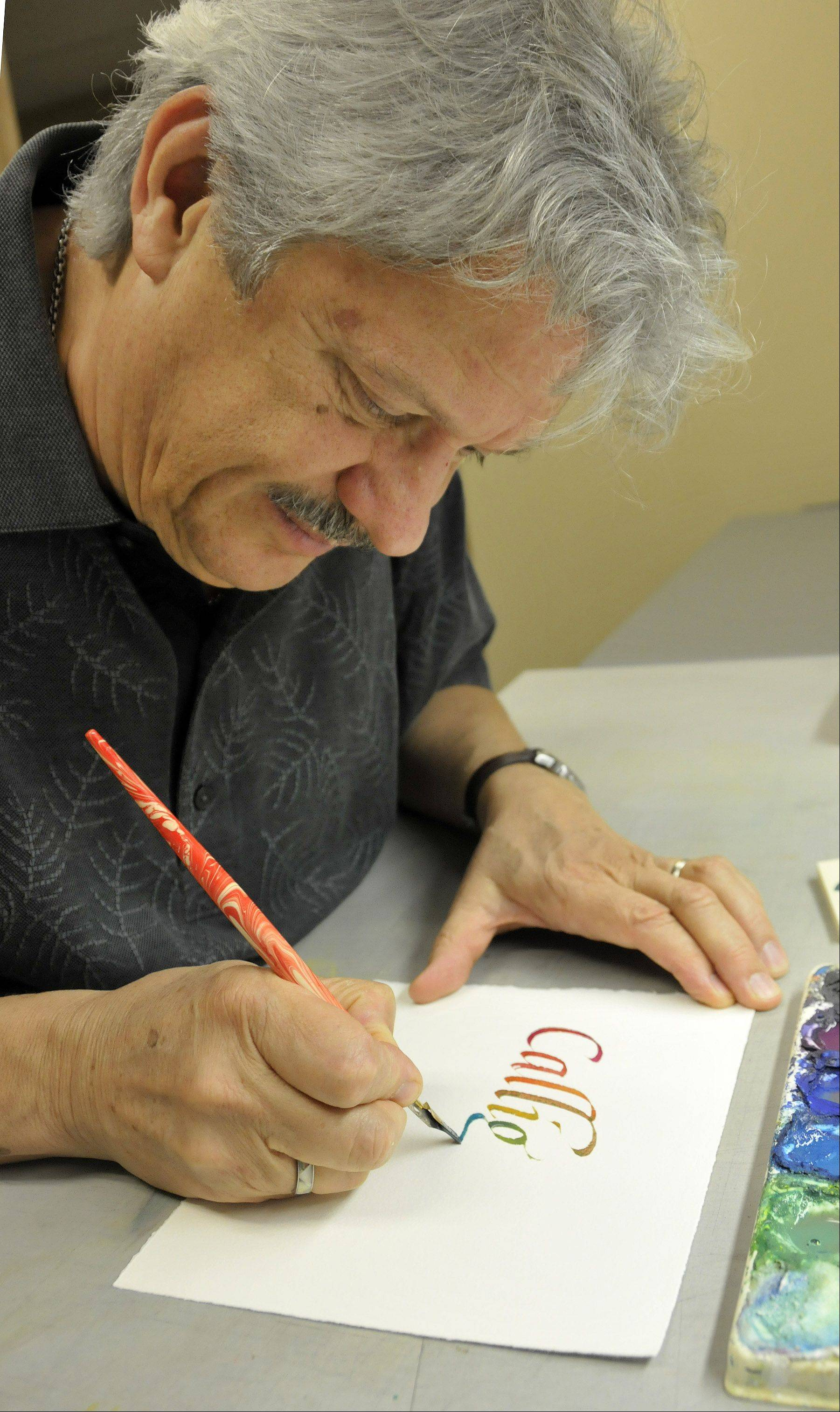 Timothy Botts illustrates his hand-drawn calligraphy. The way the color on the edges of the letters soaks into the paper is impossible to reproduce with a computer, he says. For multicolored work, he paints the watercolor onto his chisel-nibbed pen with a brush and then creates the letters.