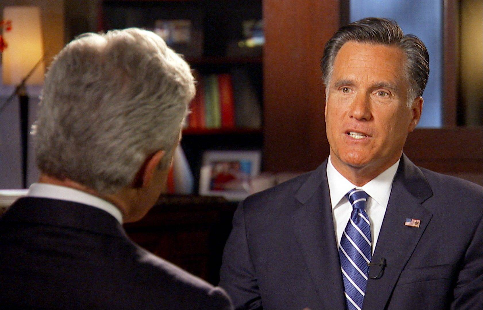 "Republican presidential candidate Mitt Romney talks with ""60 Minutes"" correspondent Scott Pelley in Boston."