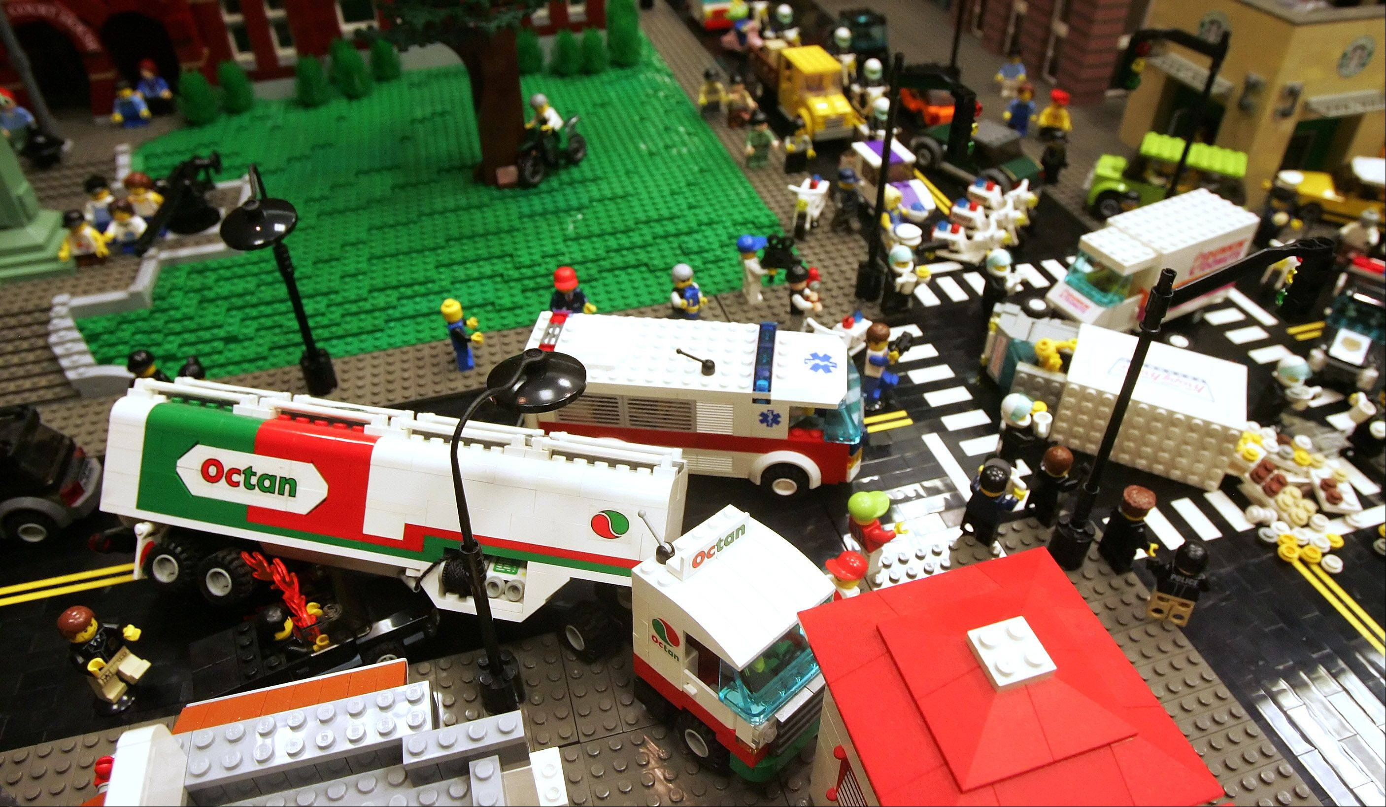 A traffic accident of Lego trucks blocks an intersection during the Northern Illinois Lego Train Club display Sunday at the Arlington Heights Memorial Library. Adults and children alike watched in amazement at all of the custom creations, vignettes and Lego mayhem as Lego trains ran through cities, villages and scenes from popular movies.