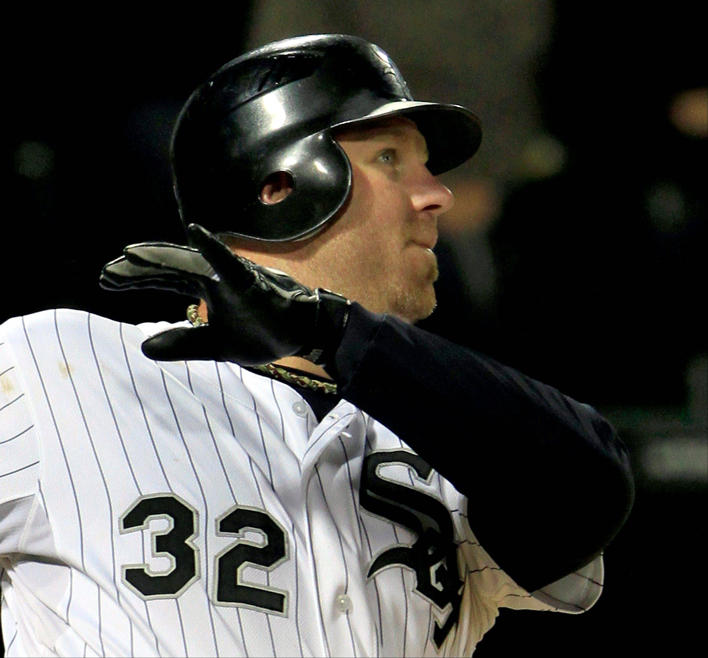 Adam Dunn watches his 3-run, game-deciding homer Monday night to keep the White Sox 1 game ahead of the second-place Tigers.