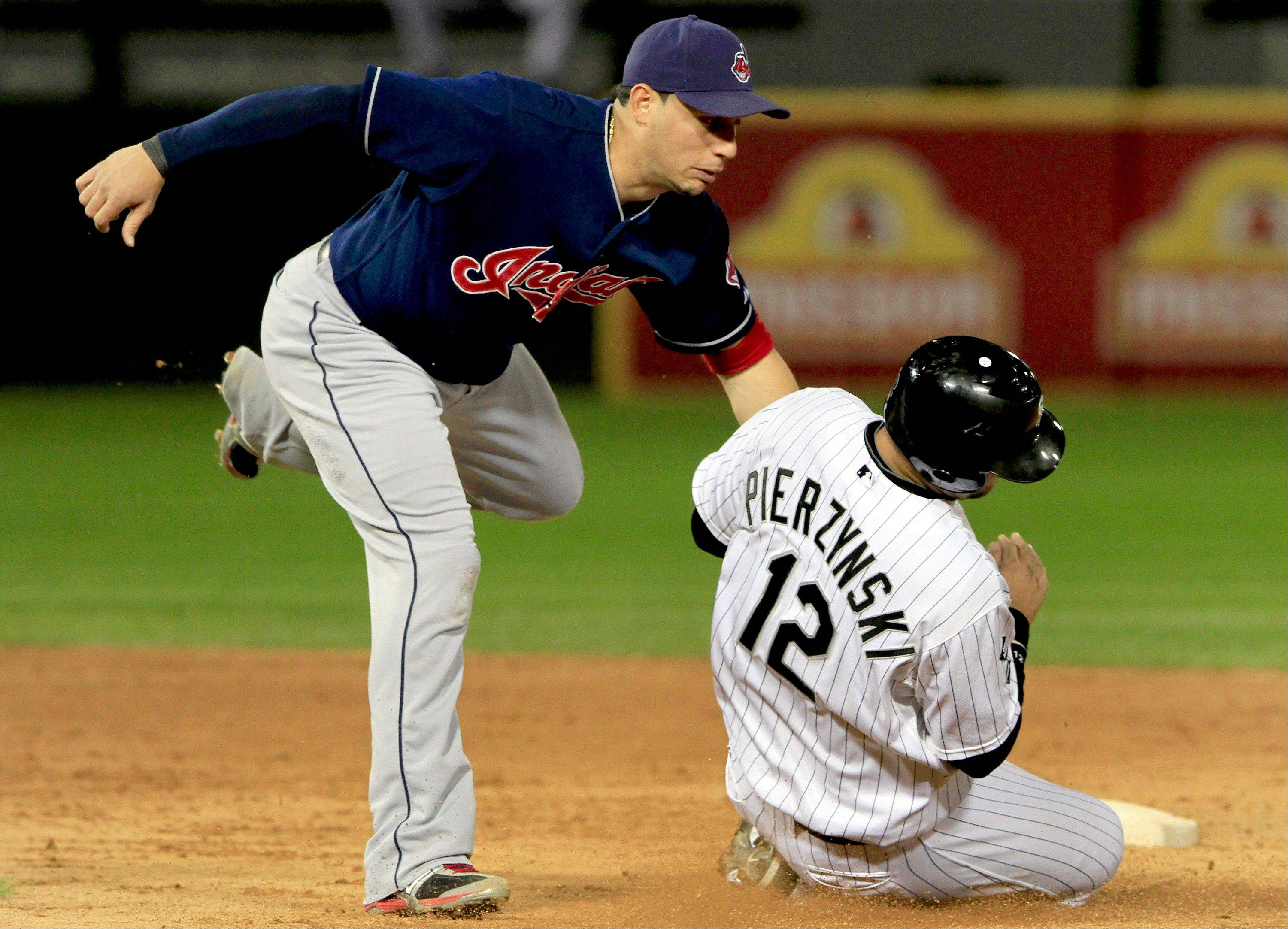 The White Sox's A.J. Pierzynski is out at second on a fielder's choice as Cleveland Indian's Asdrubal Cabrera, left, makes the tag in the fifth inning of a baseball game Monday.