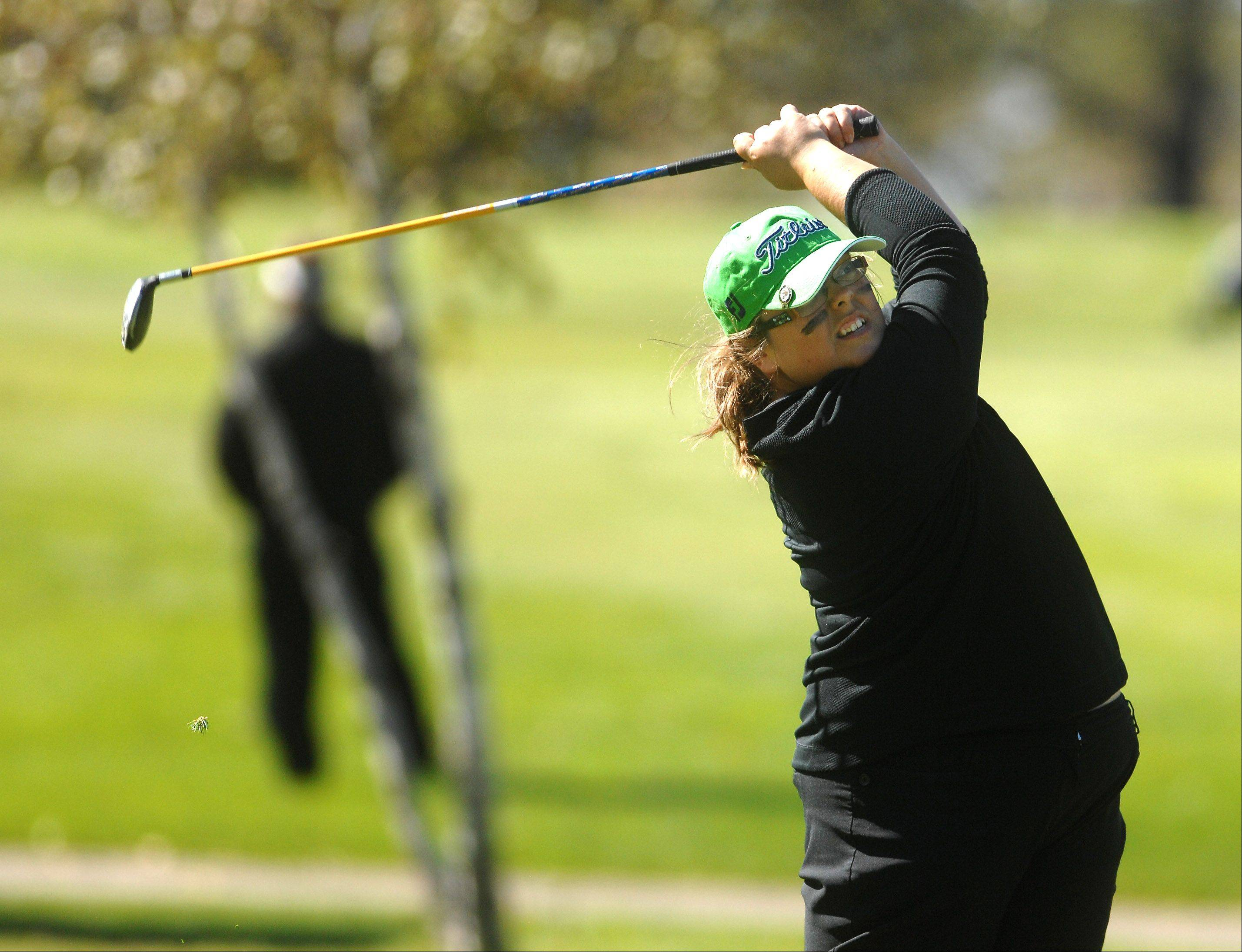 Batavia's Lauren Anderson hits a tee shot on a par 3 during Monday's Upstate Eight Conference girls golf tournament at St. Andrews Golf & Country Club in West Chicago.