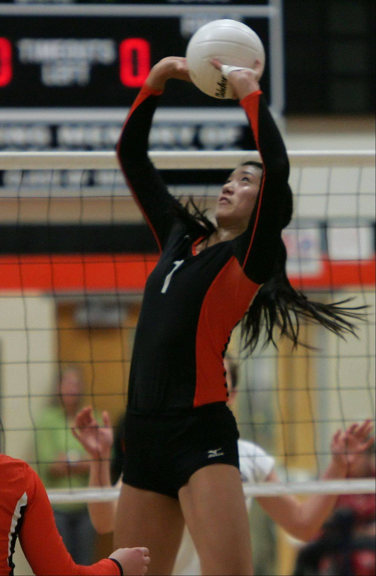 Libertyville's Cindy Zhou sets the ball Monday against visiting Carmel.