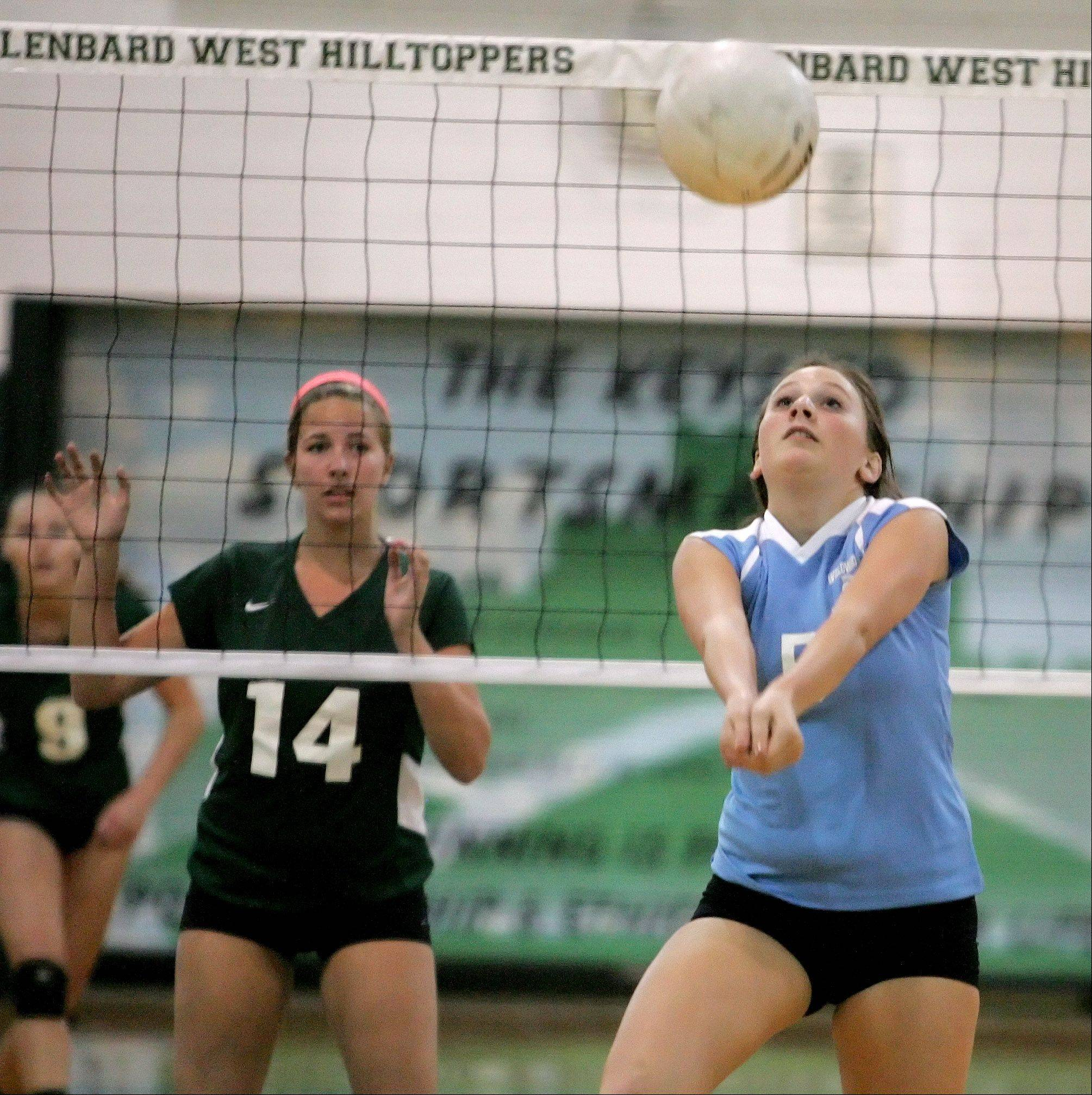Marge Annunziata of Willowbrook bumps the ball over in girls volleyball action against Glenbard West on Monday in Glen Ellyn.