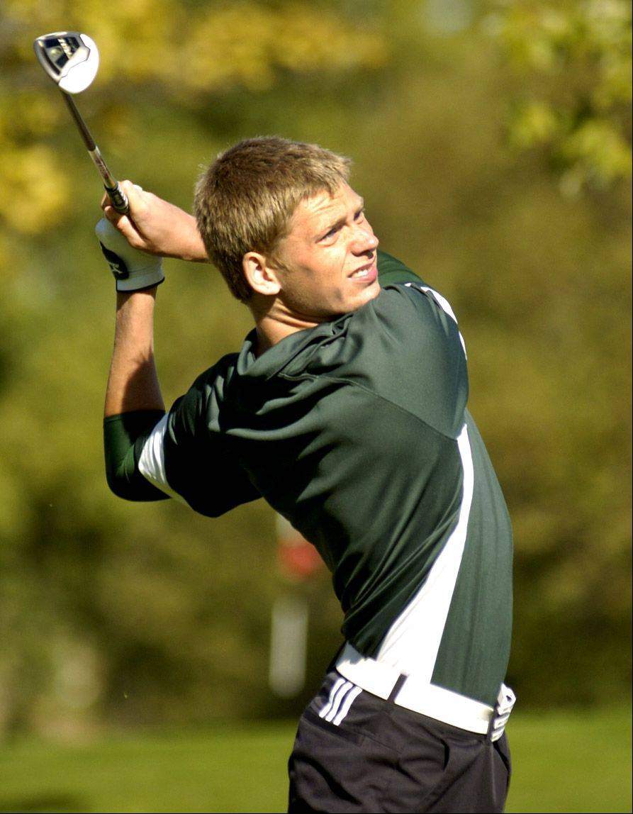 Elk Grove's Ryan White tees off on No. 1 during the Mid-Suburban League meet at Arlington Lakes.