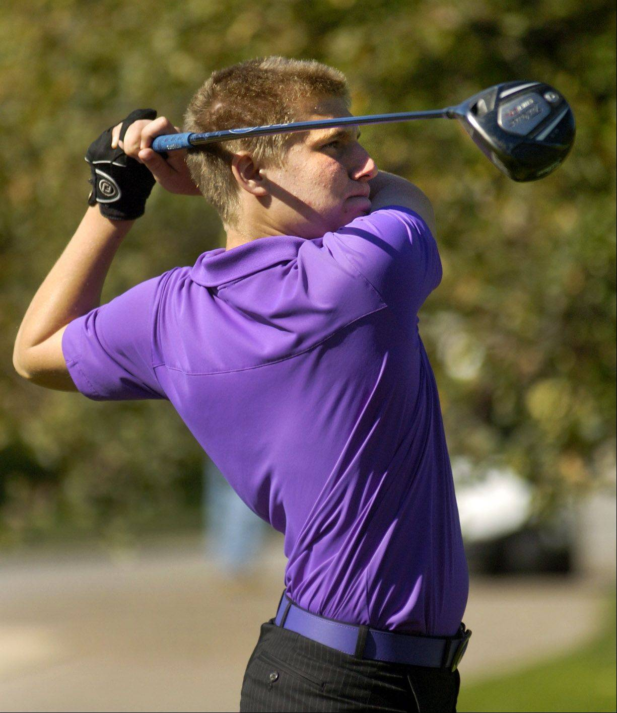 Danny Wojtowicz of Rolling Meadows tees off on No. 17 during the Mid-Suburban League meet at Arlington Lakes.