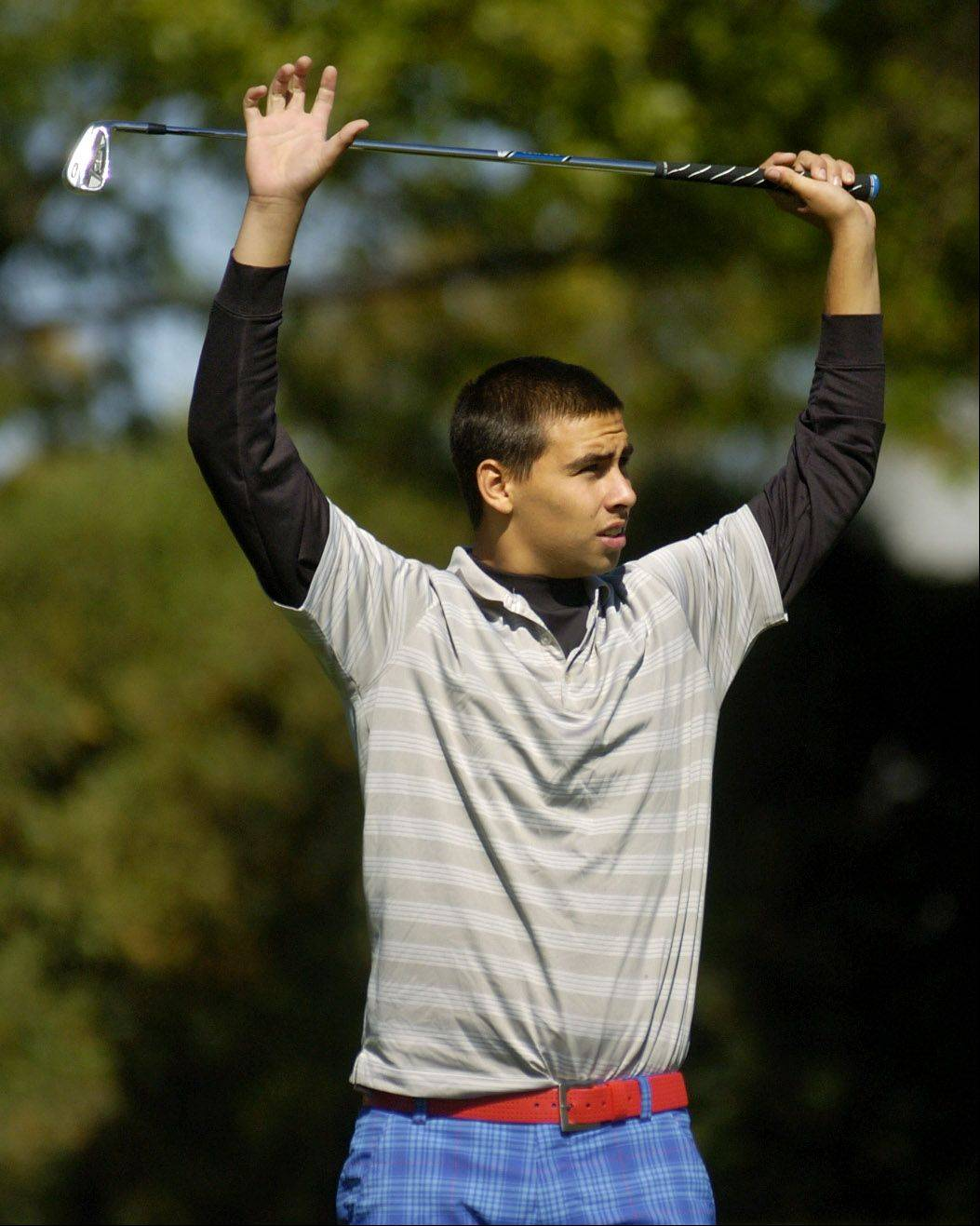 Ryan Curran of Conant watches his tee shot on 17 during the Mid-Suburban League meet at Arlington Lakes.