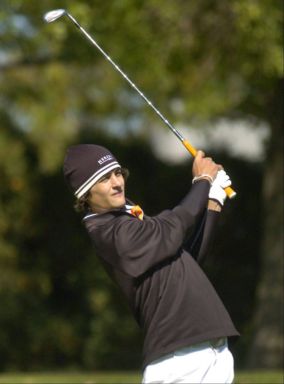 Grant Manno of Hersey watches his tee shot on 17 during the Mid-Suburban League meet at Arlington Lakes.