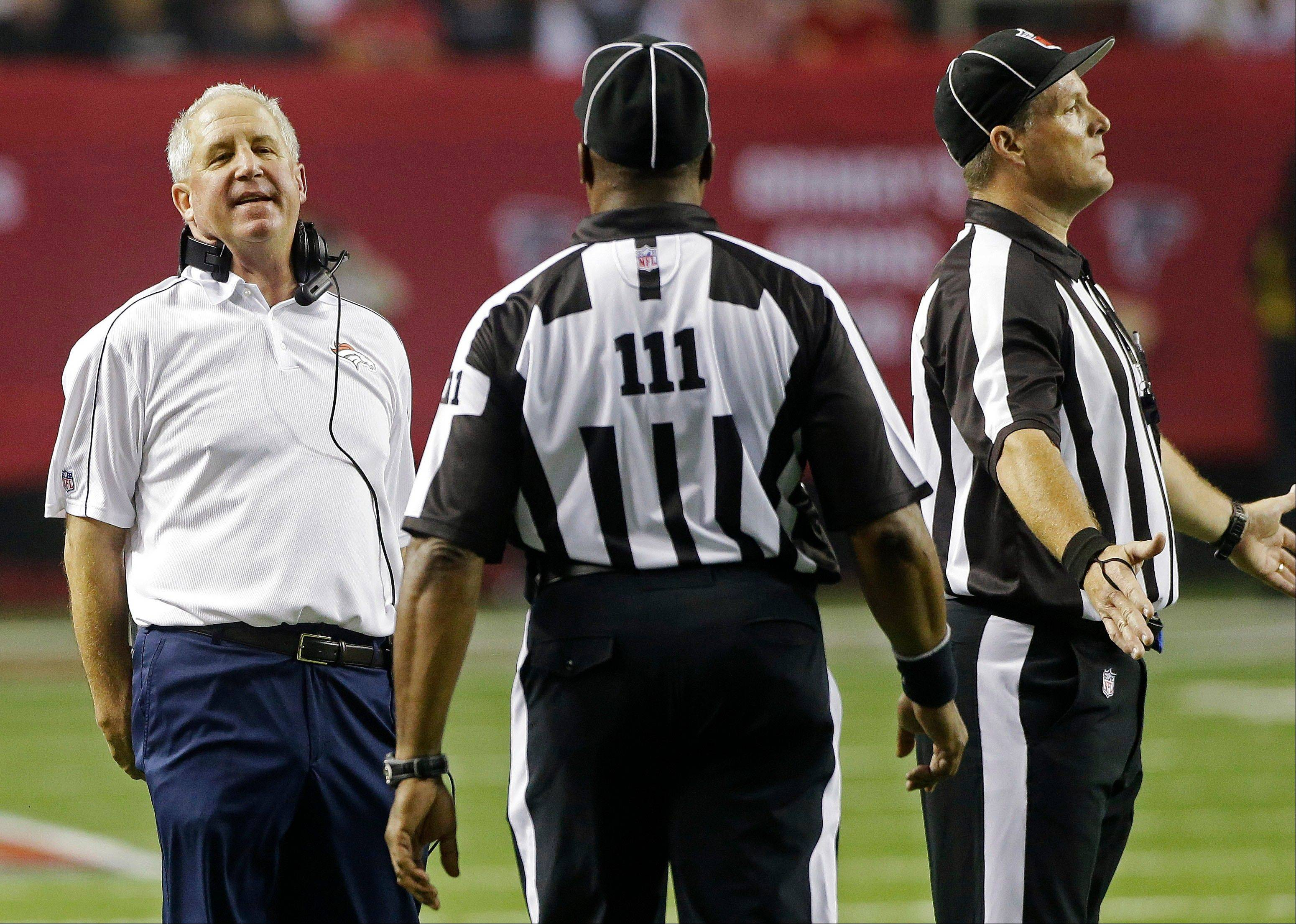 Denver Broncos head coach John Fox, left, speaks to officials during the first half of an NFL football game against the Atlanta Falcons Sept. 17 in Atlanta.