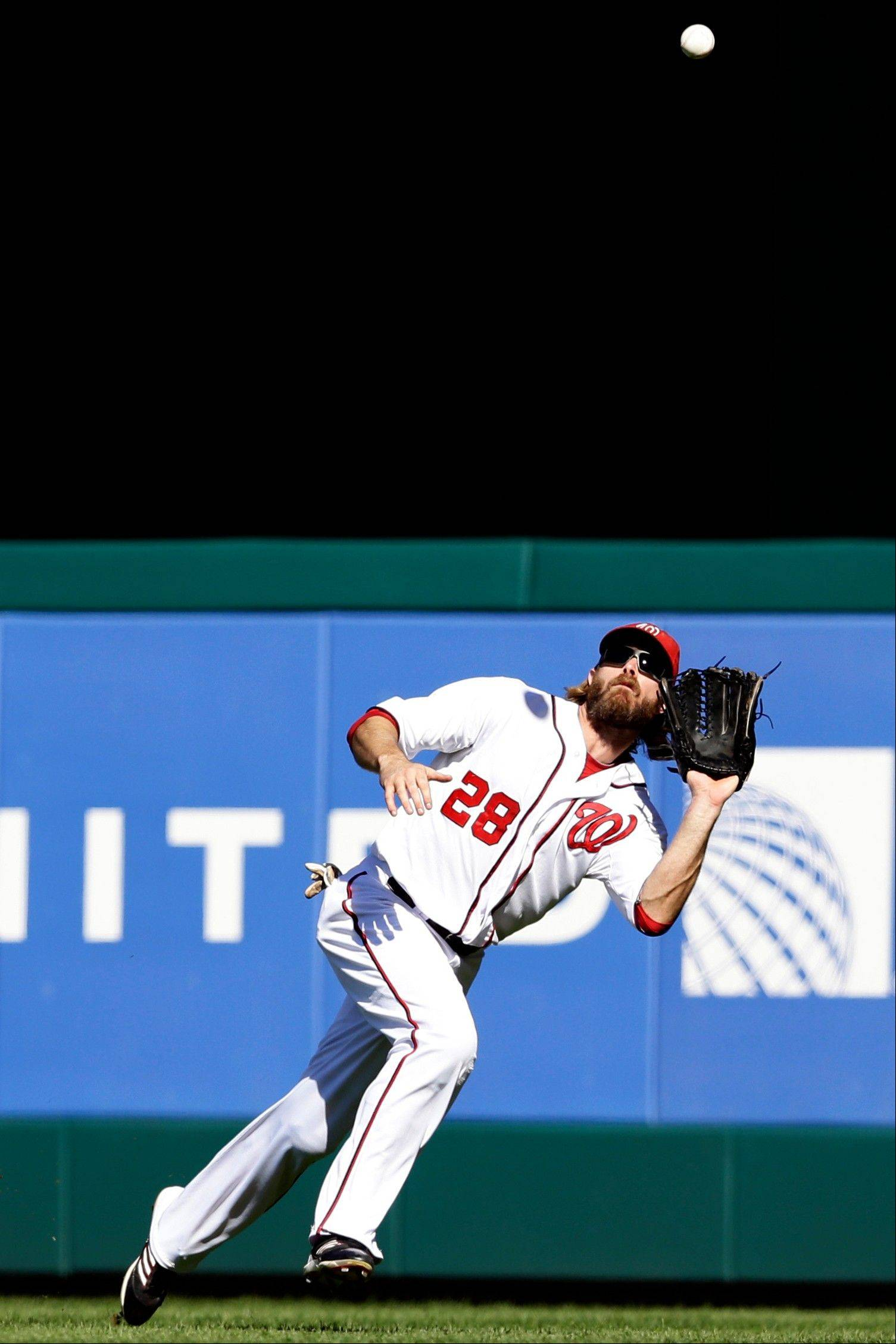 Washington Nationals right fielder Jayson Werth prepares to make the catch on a ball hit by Milwaukee Brewers Corey Hart during the sixth inning of a baseball game at Nationals Park, Monday in Washington. The Nationals won 12-2.