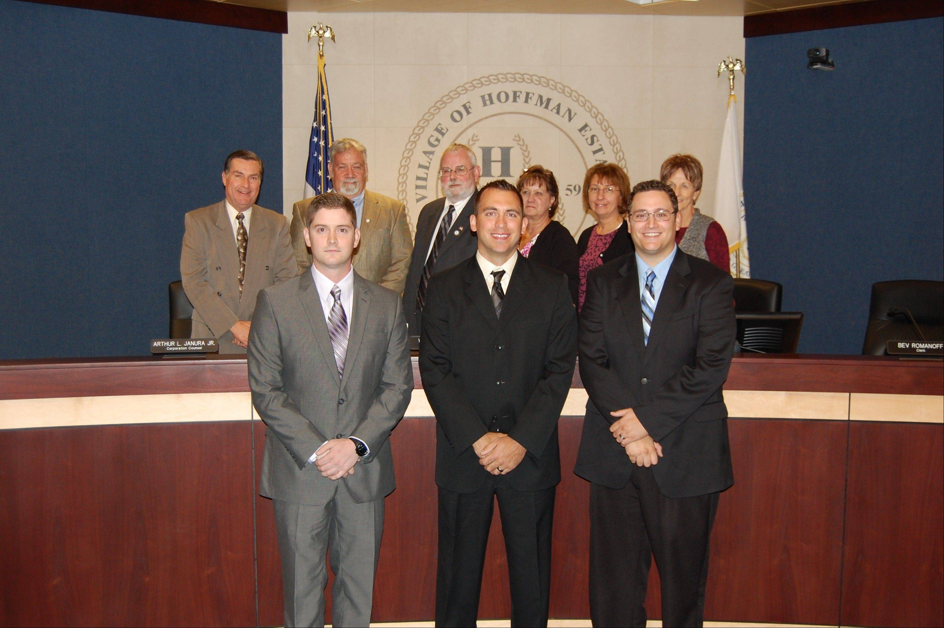 Scott Melzer, left, Matthew Fesemyer and Daniel Stopka stand in front of the village board.