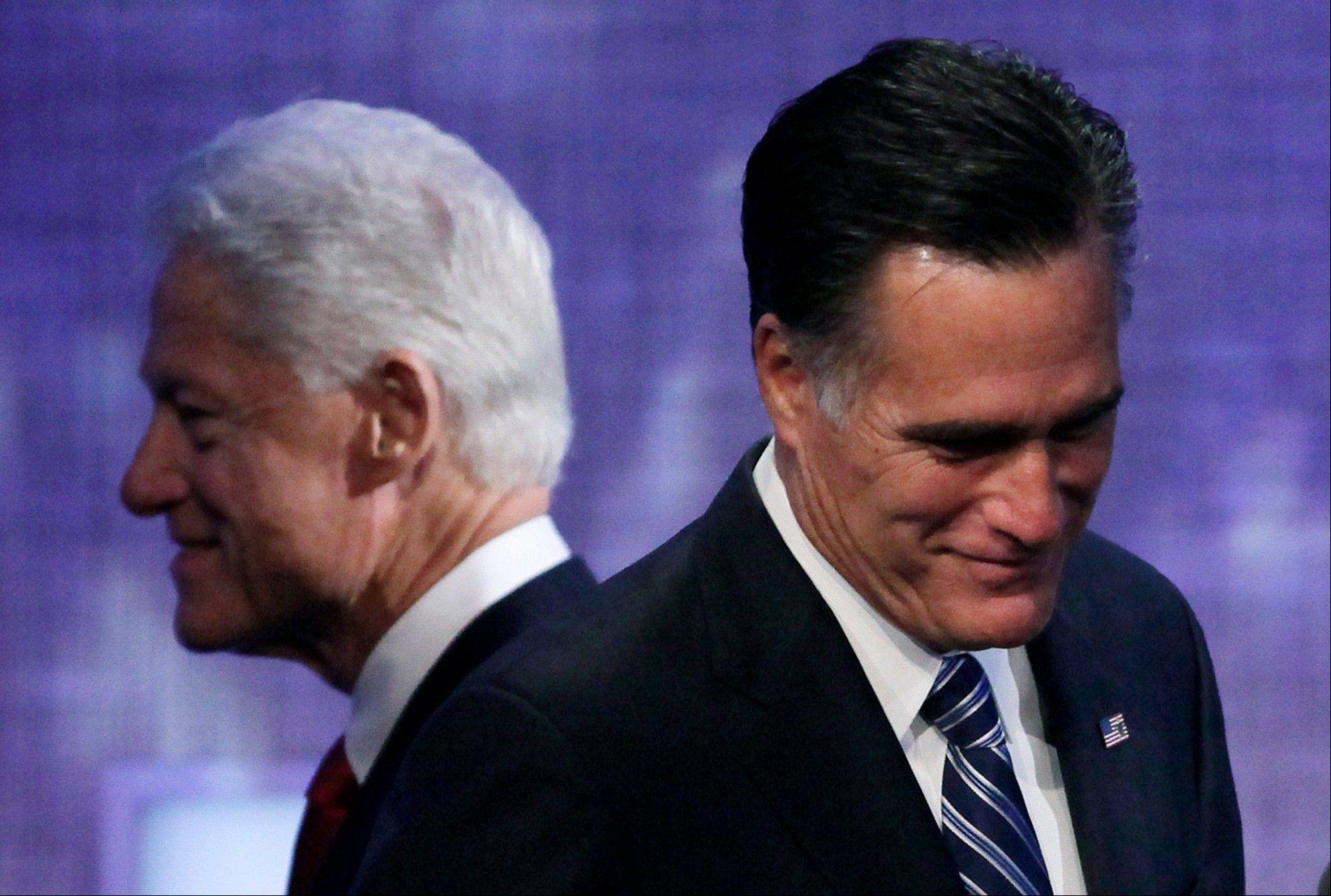 Republican presidential candidate Mitt Romney steps to the podium after an introduction by former President Bill Clinton, Tuesday, Sept. 25, 2012, at the Clinton Global Initiative in New York.