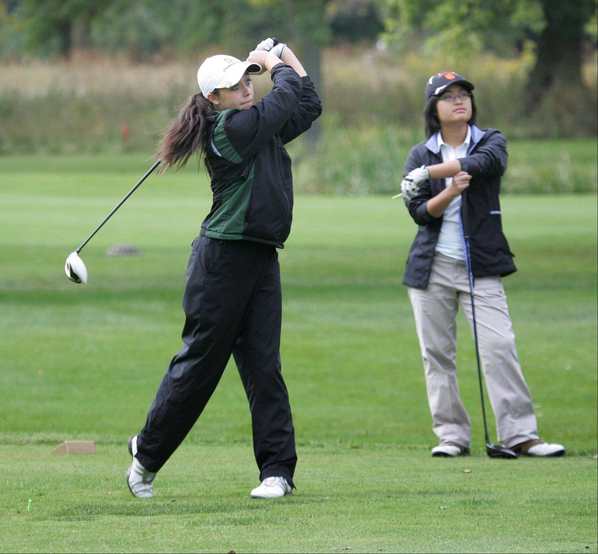 Stevenson golfer Stephanie Miller tees off on the third hole during the North Suburban Conference girls golf tournament Tuesday at Deerpath Golf Course in Lake Forest. Libertyville golfer Camilla Ou is to the right.