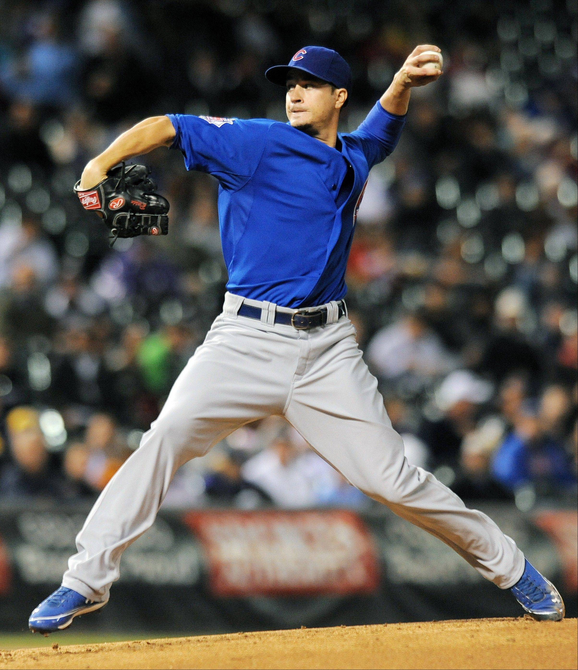 Cubs starter Chris Rusin throws in the first inning Tuesday at Coors Field against the Rockies.