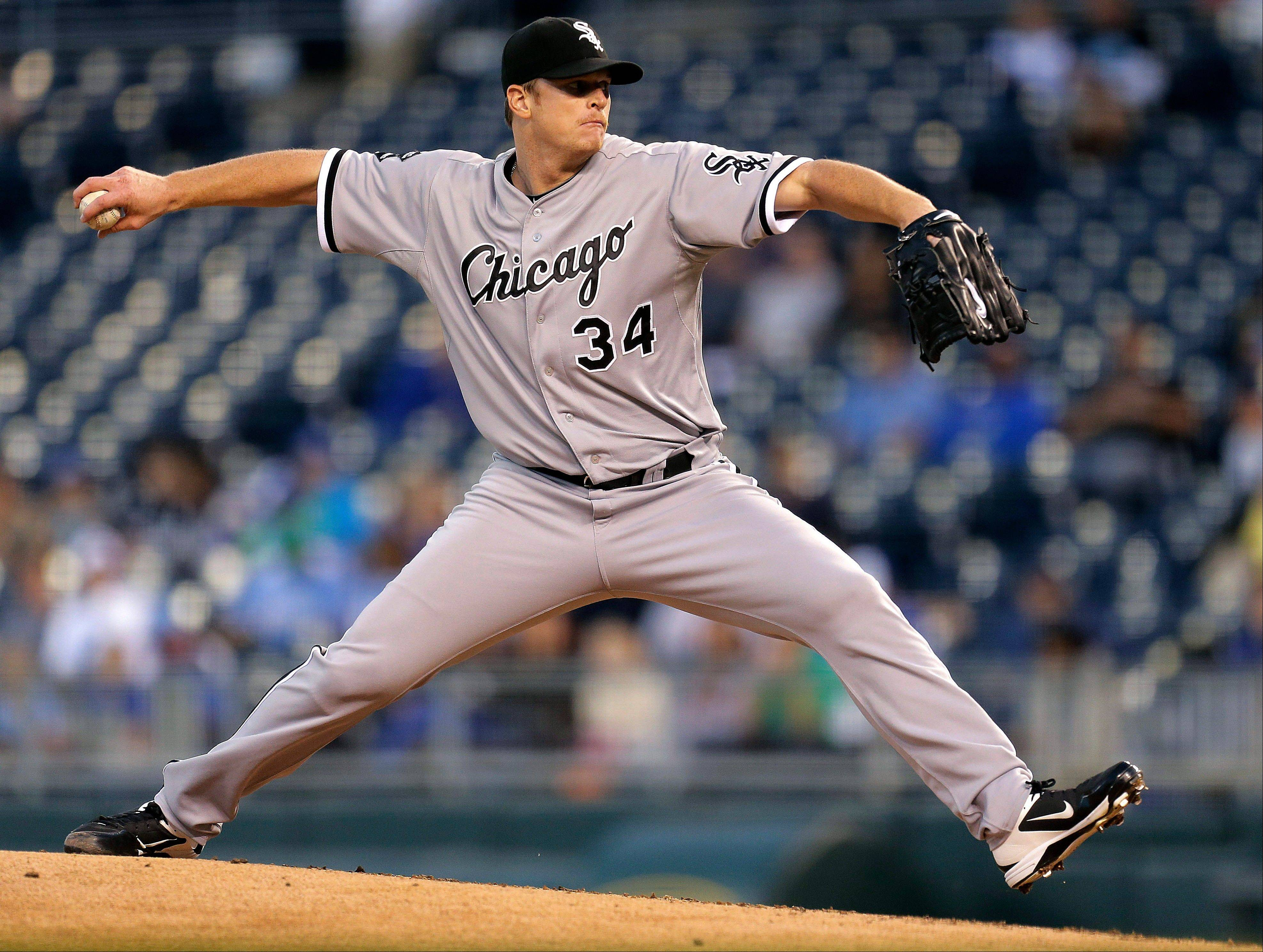 White Sox starting pitcher Gavin Floyd throws during the first inning of a baseball game against the Kansas City Royals, Tuesday, Sept. 18, 2012, in Kansas City, Mo.