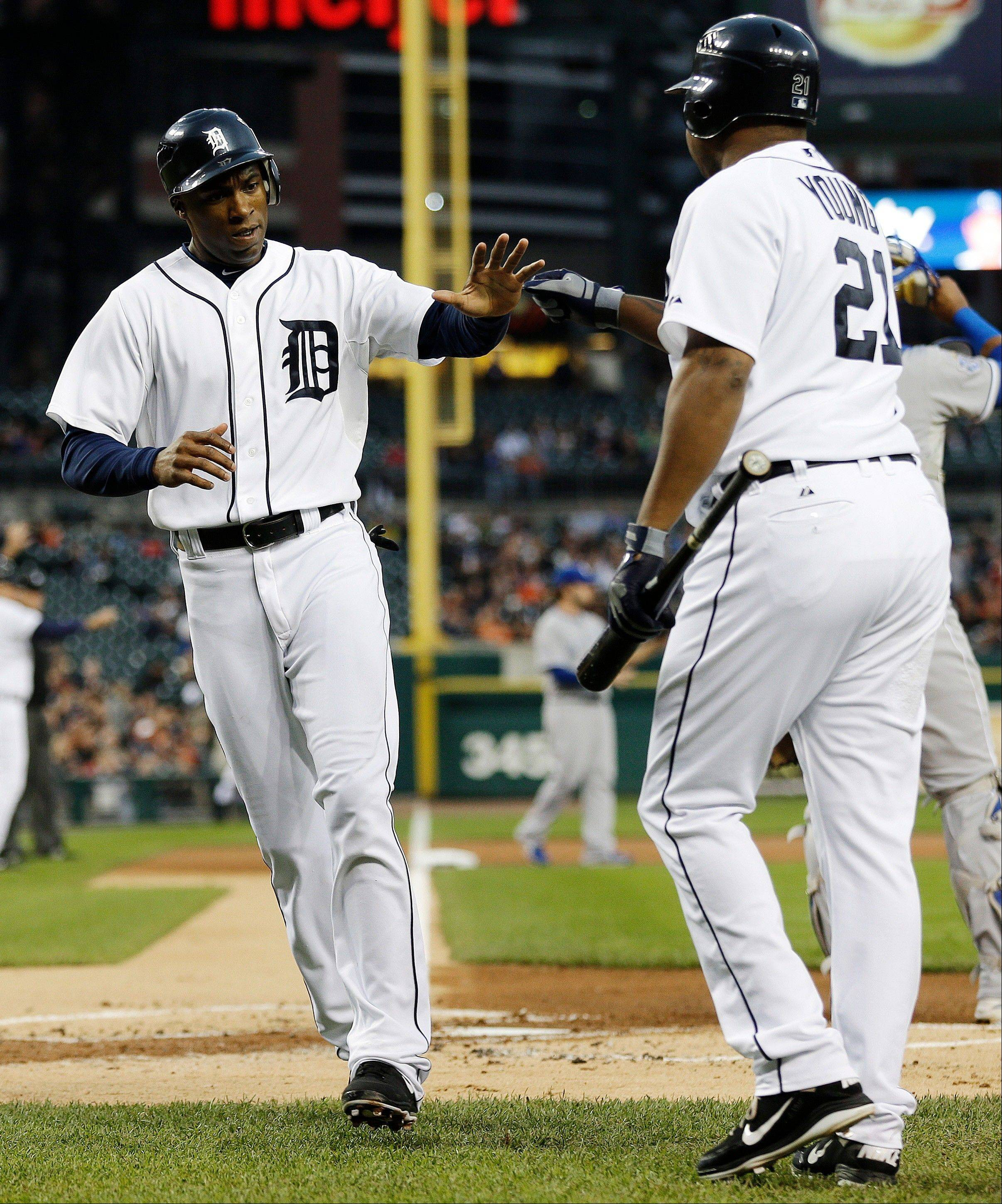 Detroit Tigers center fielder Austin Jackson, left, is congratulated by Delmon Young after scoring on an RBI single by Prince Fielder Tuesday against the Kansas City Royals.